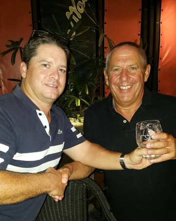 Neil Carter presents the Golfer of the Month trophy to Keith Norman.