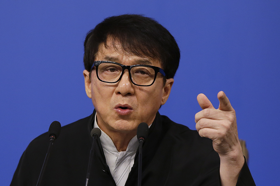 Hong Kong movie star Jackie Chan speaks to the media at a press conference in Beijing, Tuesday, March 7. (AP Photo/Andy Wong)