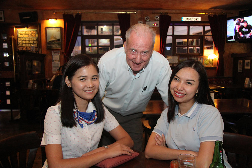 Dr. Iain Corness hovers over Nui and Tanya from the BHP International Marketing Department.