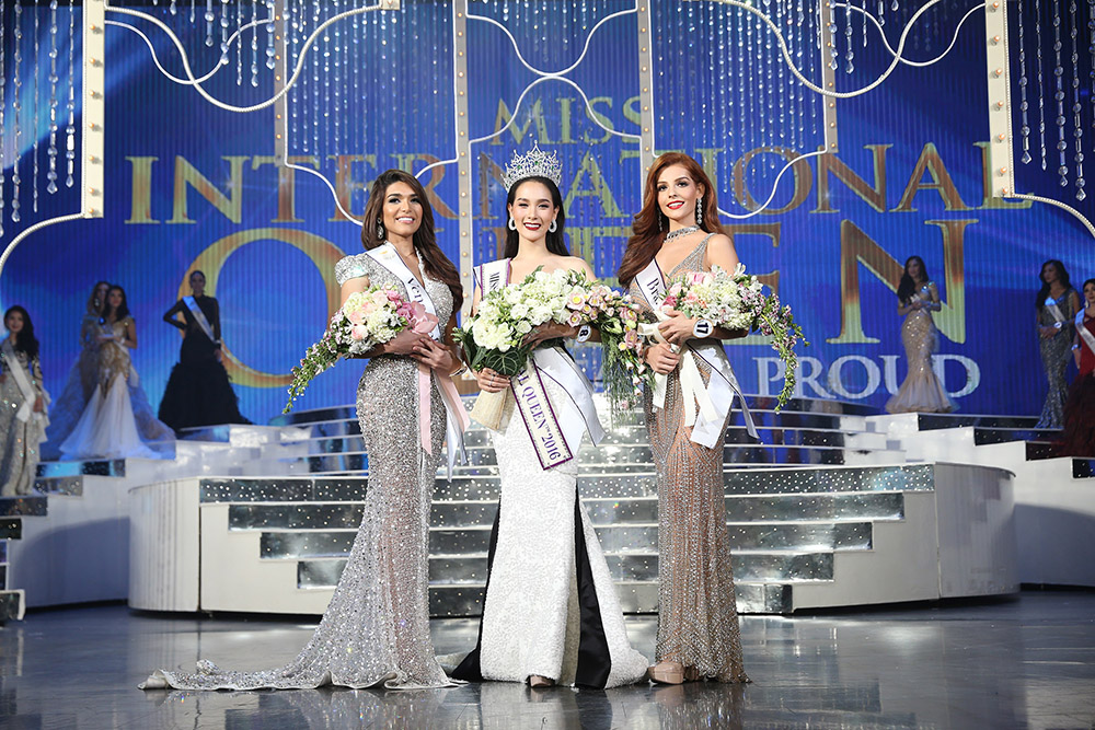 Jiratchaya Sirimongkolnawin (center) won the 2017 Miss International Queen transgender beauty pageant. She is flanked by runner-up Nathalie de Oliveira (right) from Brazil and second runner-up Andrea Collazo (left) of Venezuela.