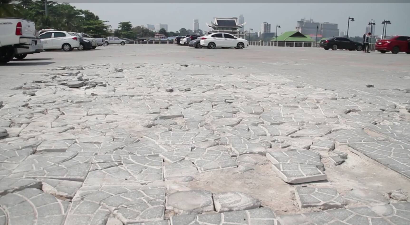 The multipurpose zone of Naklua's Lan Po Public Park was heavily damaged after city hall allowed cars to park on the unreinforced pavement.