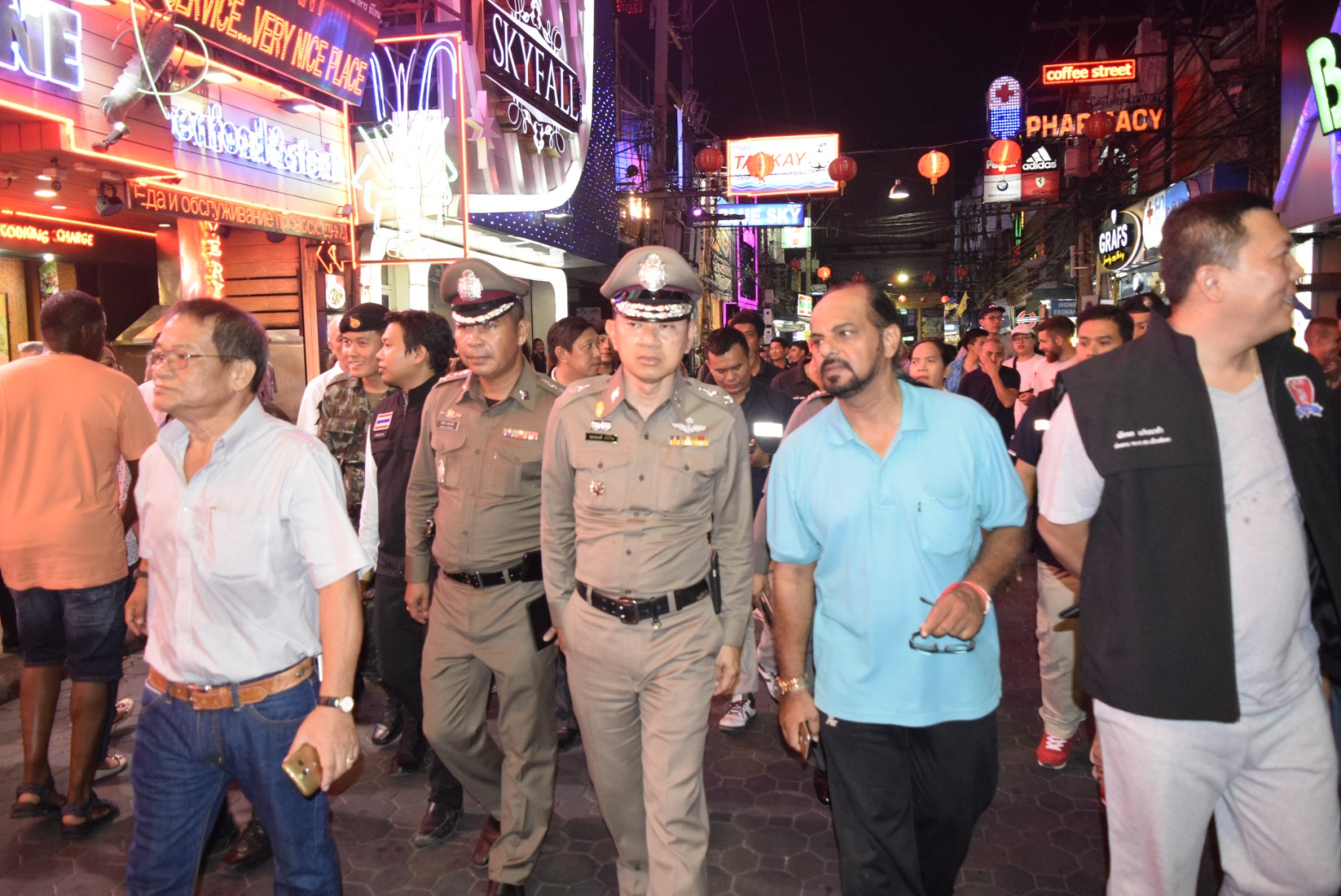 Following the meeting, the entourage walked the nightlife strip and chatted with tourists.