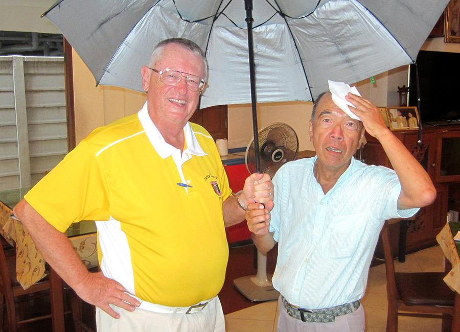 Dick Warberg (left) with a damp Mashi Kaneta.