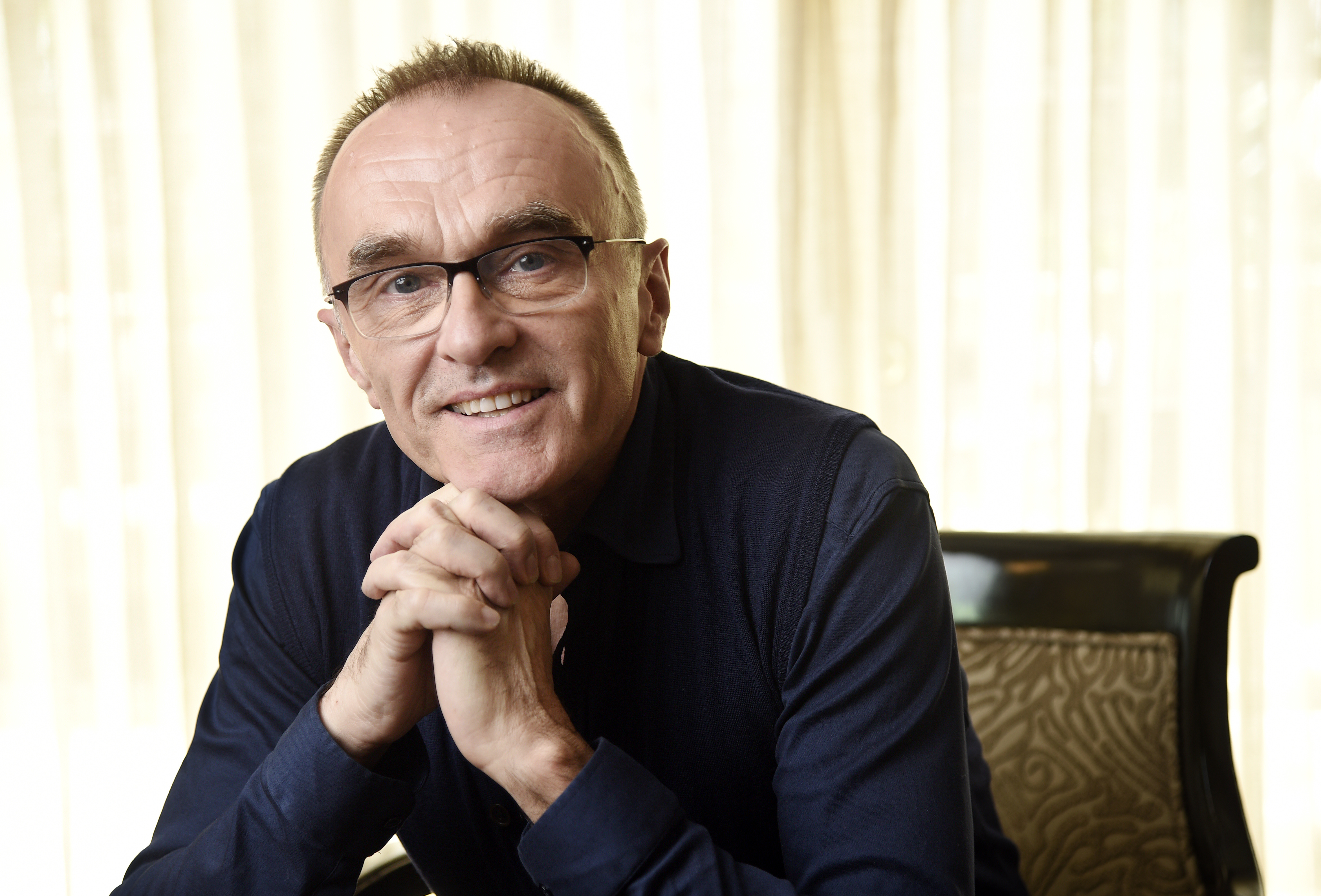"""Director Danny Boyle poses for a portrait at the Four Seasons Hotel in Beverly Hills, Calif. in this March 6, 2017 photo, to promote his new film, """"T2: Trainspotting."""" (Photo by Chris Pizzello/Invision/AP)"""