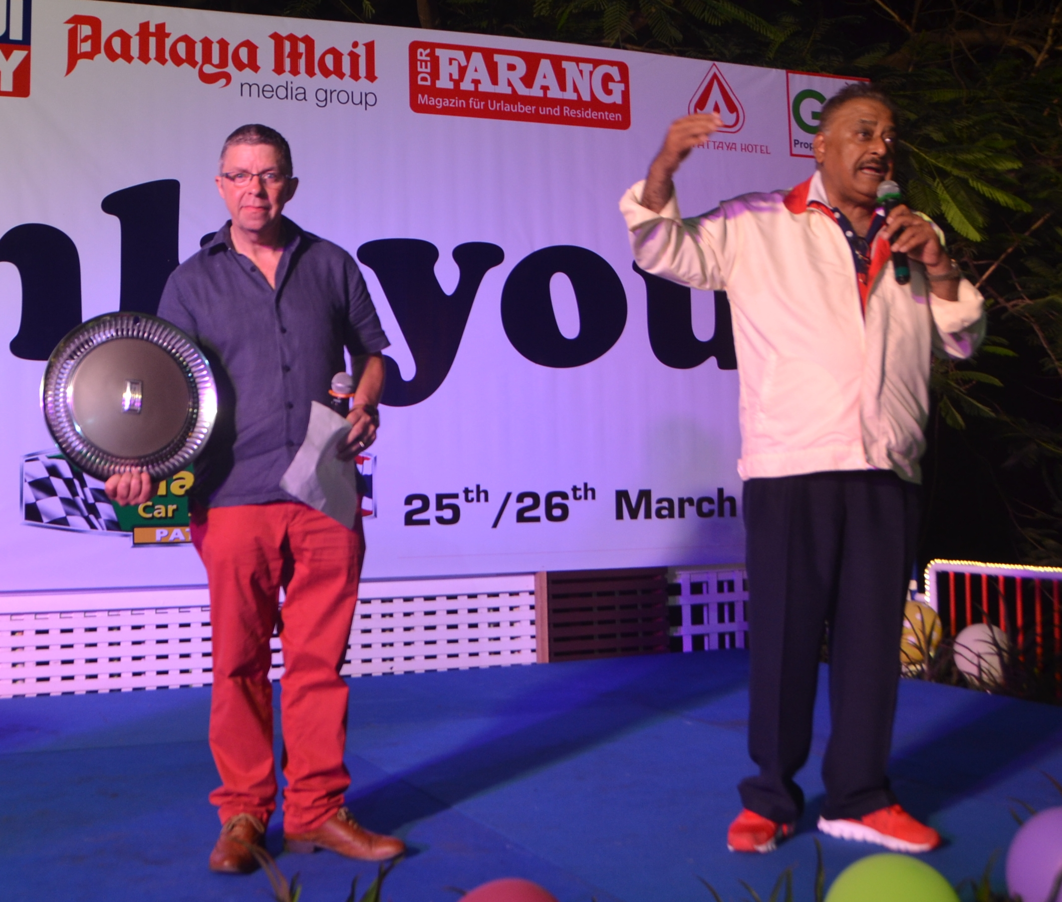 Paul Strachan and Peter Malhotra conduct the auction helping to raise over 100,000 baht.