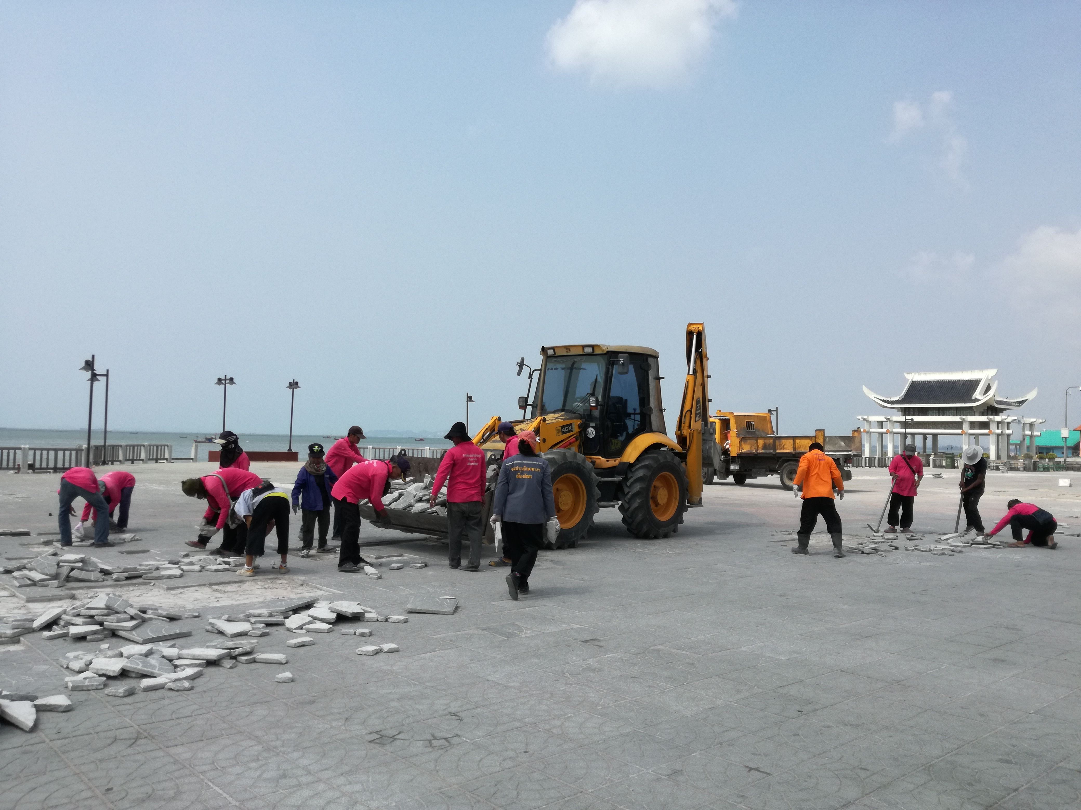 Pattaya city work crews repaired the multipurpose zone of Naklua's Lan Po Public Park after it was heavily damaged by cars parking on the unreinforced pavement.
