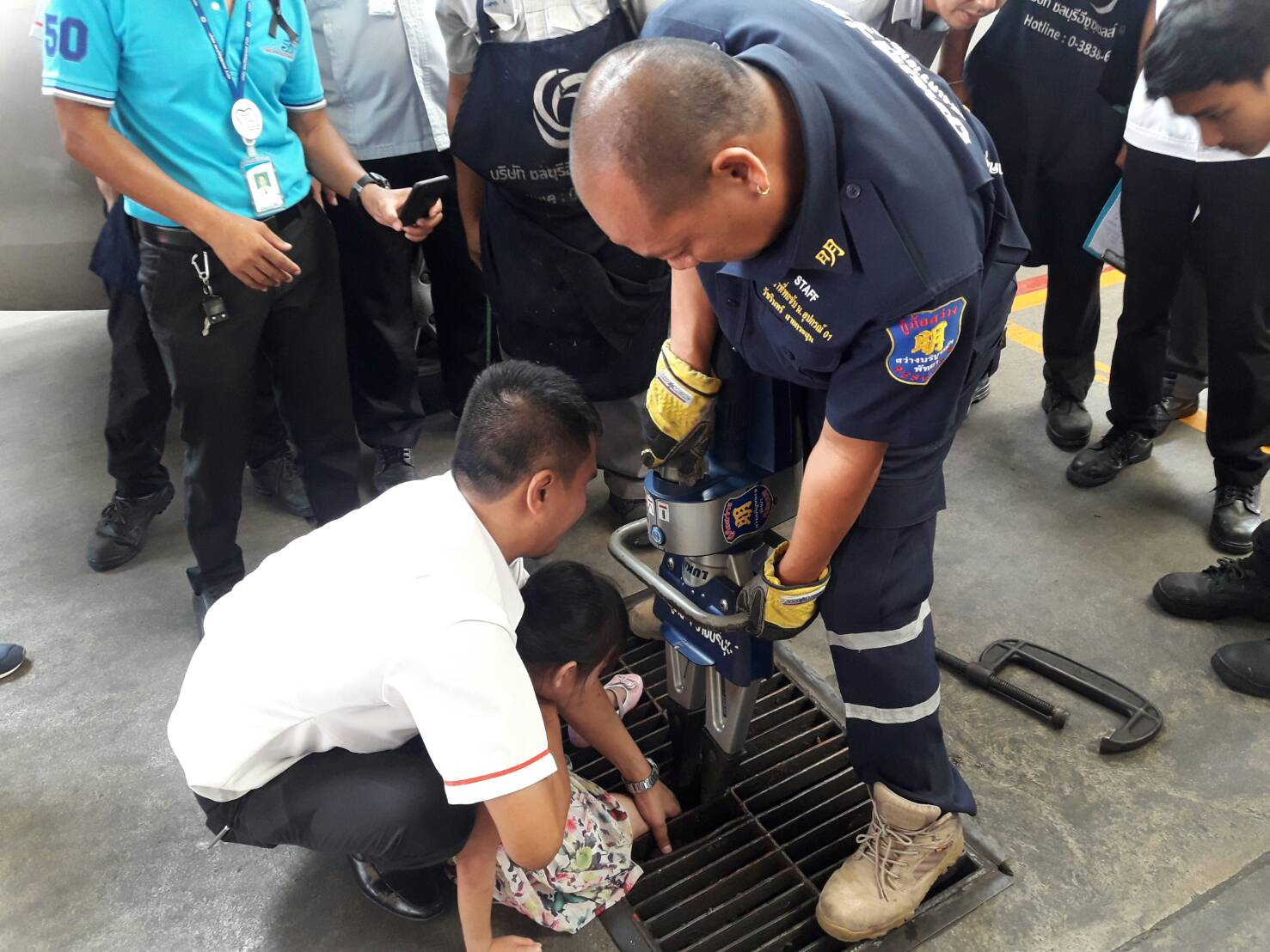 A 6-year-old girl escaped serious injury after getting her leg stuck in a grated drain cover.
