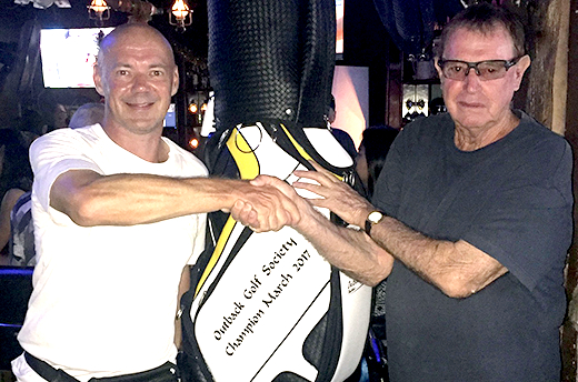 Bruce McAdam (right) receives his prize golf bag from the Outback Bar's Andre Coetzee.