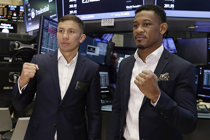"Middleweight boxers Gennady ""Triple G"" Golovkin, left, and Daniel Jacobs, right, who will face each other in a unification bout Saturday March 18, pose for photos in New York, Monday, March 13. (AP Photo/Richard Drew)"