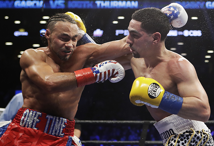 Keith Thurman, left, fights Danny Garcia during the fifth round of their welterweight championship bout, Saturday, March 4, in New York. (AP Photo/Frank Franklin II)