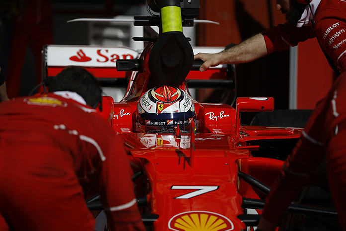 Ferrari driver Kimi Raikkonen of Finland sits in his car as mechanics push it back to the team box during a Formula One pre-season testing session at the Catalunya racetrack in Montmelo, outside Barcelona, Spain, Friday, March 10. (AP Photo/Francisco Seco)
