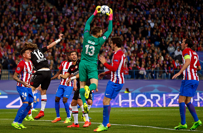 Atletico goalkeeper Jan Oblak makes a save during the Champions League round of 16 second leg match between Atletico Madrid and Bayer Leverkusen at the Vicente Calderon stadium in Madrid, Spain, Wednesday, March 15. (AP Photo/Daniel Ochoa de Olza)