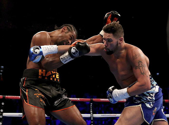 Britain's Tony Bellew, right, and David Haye are shown in action during their heavyweight contest in London, Saturday March 4. (Nick Potts/PA via AP)