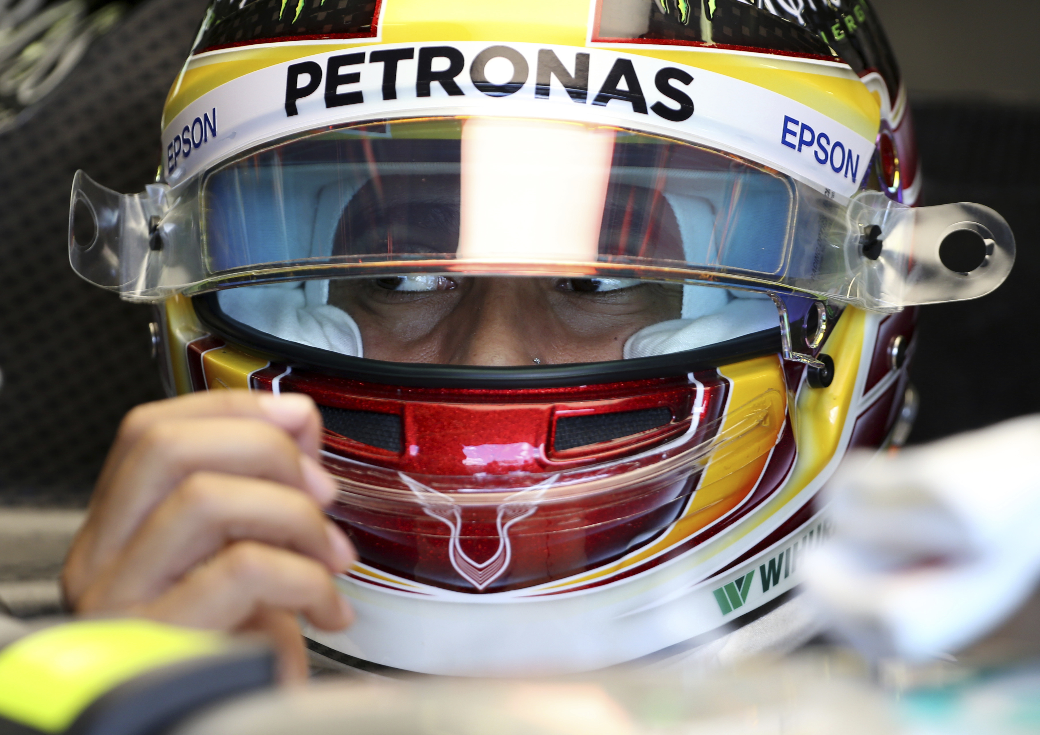 Mercedes driver Lewis Hamilton of Britain waits in his car during the final practice session for the Australian Formula One Grand Prix in Melbourne, Australia, Saturday, March 25. (AP Photo/Rick Rycroft)