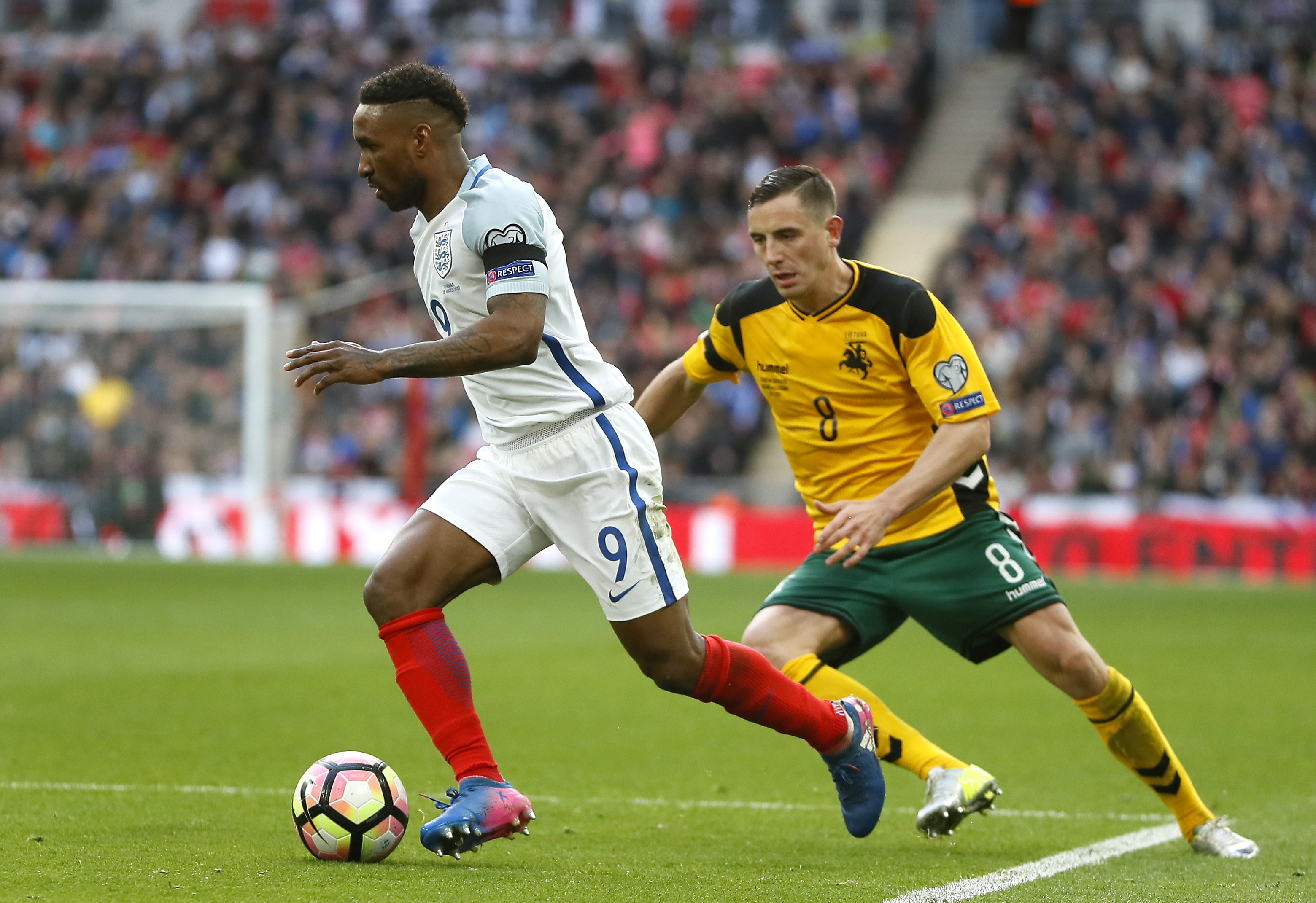 England's Jermain Defoe, left, moves away from Lithuania's Egidijus Vaitkunas, right, during the World Cup Group F qualifying match at Wembley Stadium in London, Sunday, March 26. (AP Photo/Kirsty Wigglesworth)