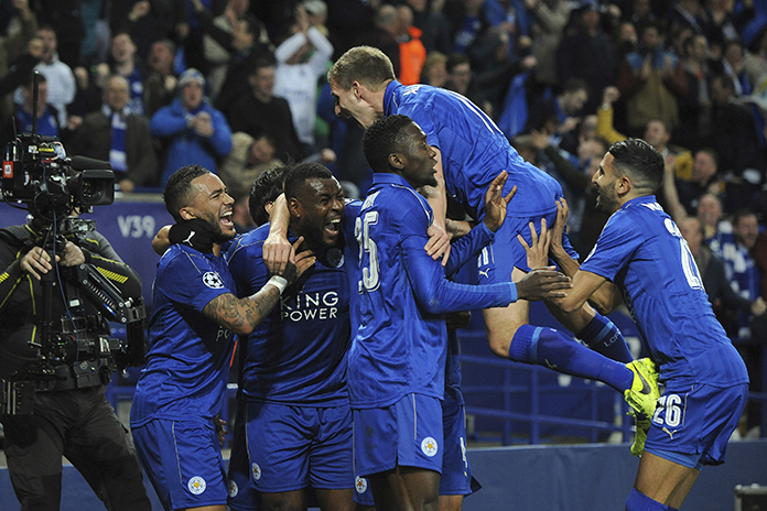 Leicester's Wes Morgan, second left, celebrates with team mates after he scored the opening goal during the Champions League round of 16 second leg match against Sevilla at the King Power Stadium in Leicester, England, Tuesday, March 14. (AP Photo/Rui Vieira)