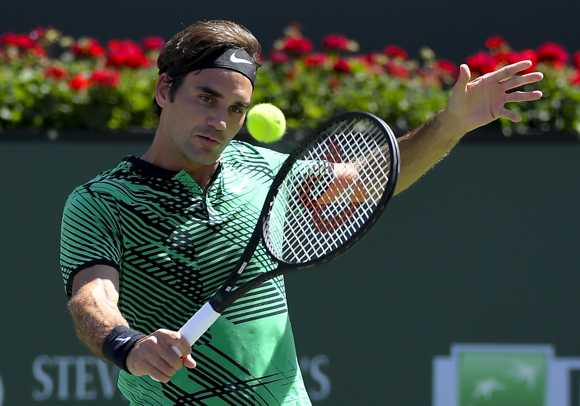Roger Federer, of Switzerland, hits to Jack Sock during their semifinal match at the BNP Paribas Open tennis tournament, Saturday, March 18, in Indian Wells, Calif. (AP Photo/Mark J. Terrill)