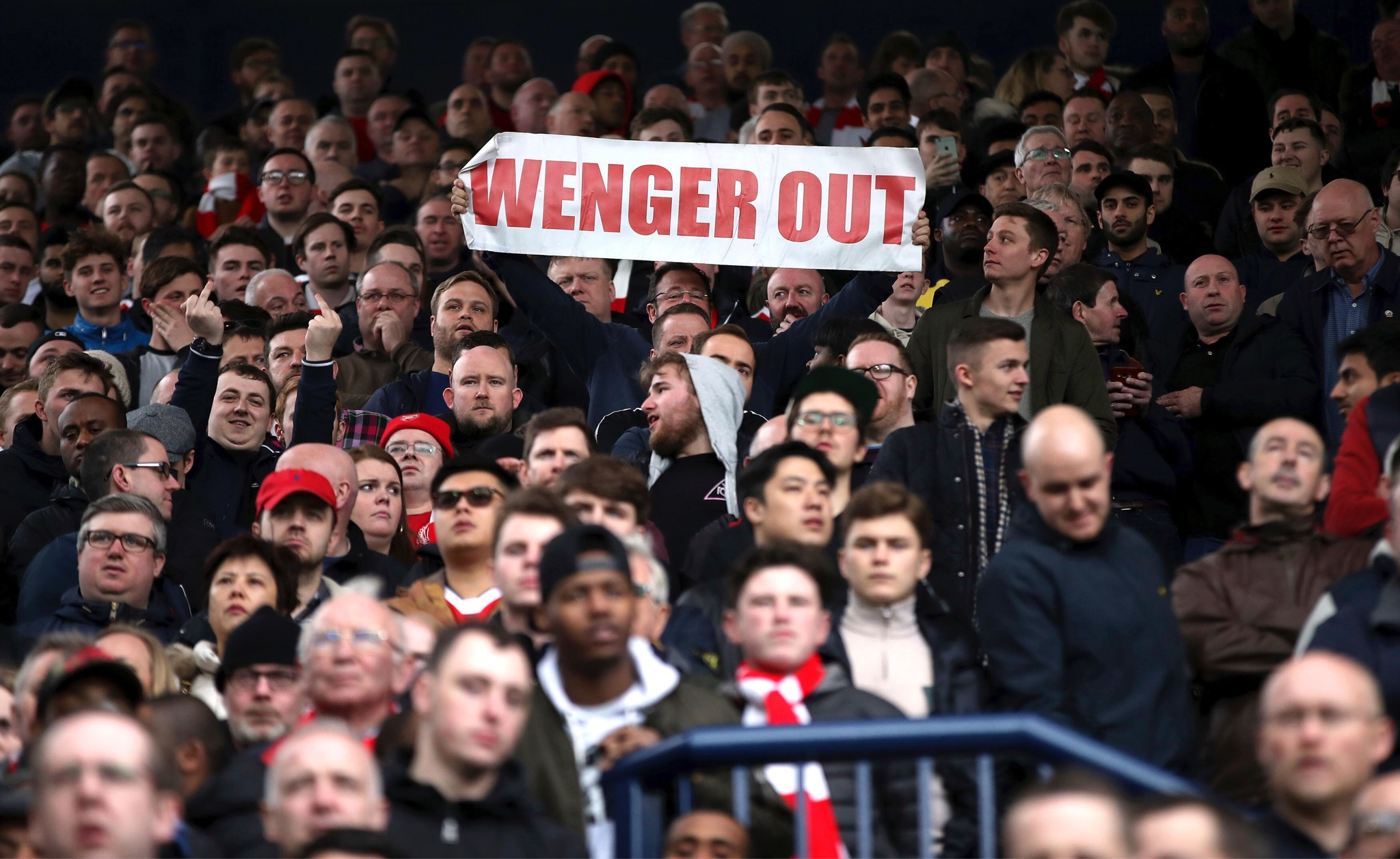 An Arsenal fan holds up a banner during the English Premier League match between West Bromwich Albion and Arsenal, at The Hawthorns, in West Bromwich, England, Saturday March 18. (Nick Potts/PA via AP)