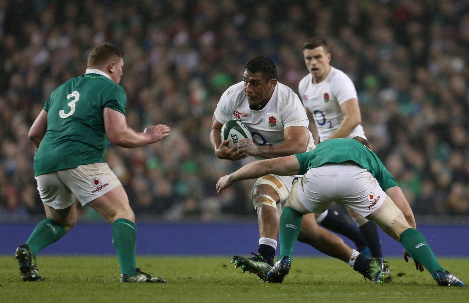England's Billy Vunipola is tackled by Ireland's Peter O'Mahony during their Six Nations rugby union international match at the Aviva stadium in Dublin, Ireland, Saturday, March 18. (AP Photo/Peter Morrison)