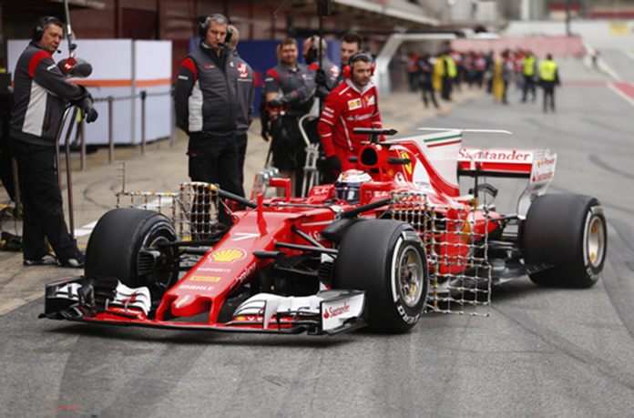Ferrari driver Kimi Raikkonen of Finland steers his car in the pit lane during a Formula One pre-season testing session at the Catalunya racetrack in Montmelo, outside Barcelona, Spain, Tuesday, Feb. 28, 2017. (AP Photo/Francisco Seco)