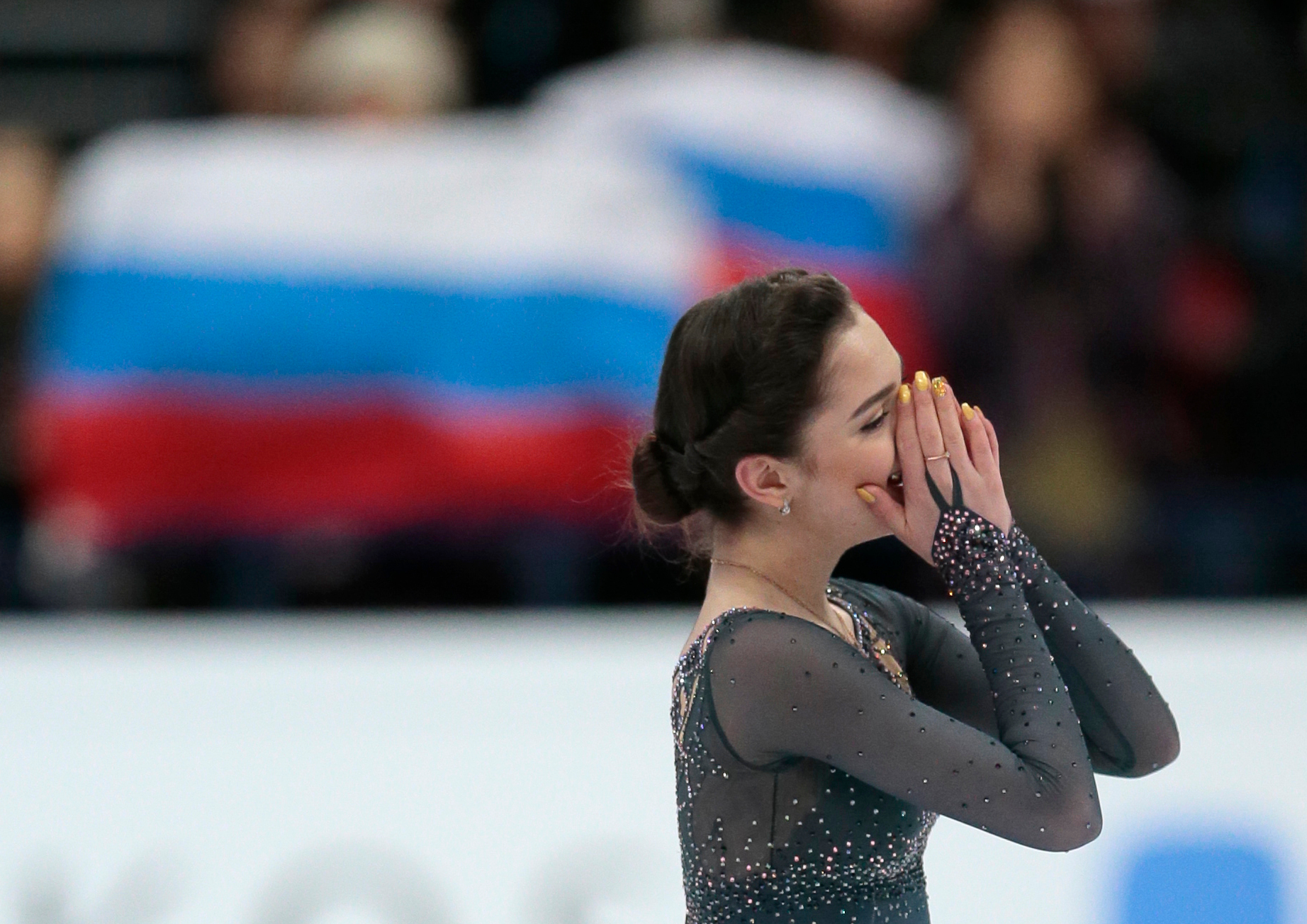 Evgenia Medvedeva, of Russia, covers her face after her free program at the World figure skating championships in Helsinki, Finland, on Friday, March 31. (AP Photo/Ivan Sekretarev)