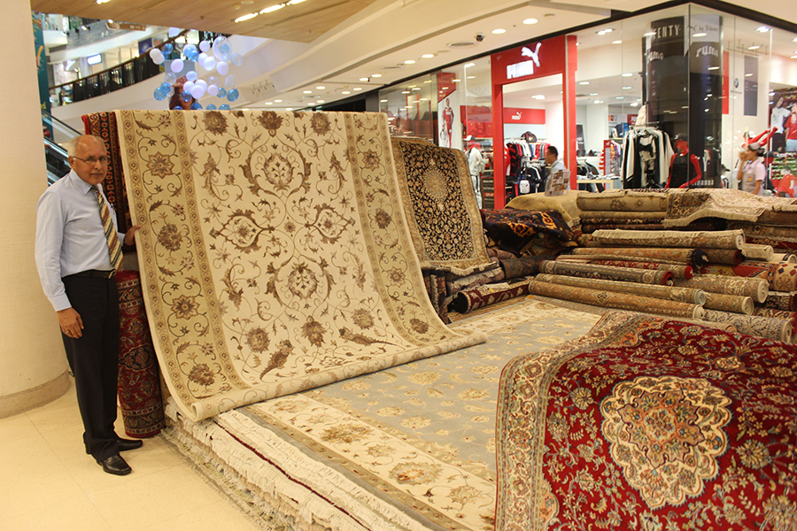 Malik shows a fine example of one of the many rugs and carpets available.