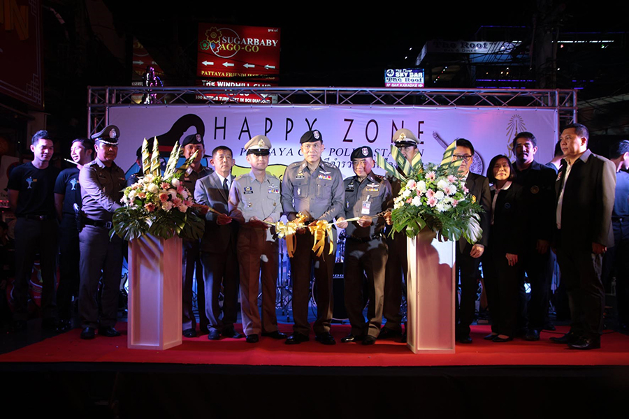 """National deputy police chief Pol. Gen. Chalermkiat Sriworakan cut the ribbon with top local police and government officials present to officially open its first """"happy zone"""" on Walking Street in an effort to improve safety for tourists."""