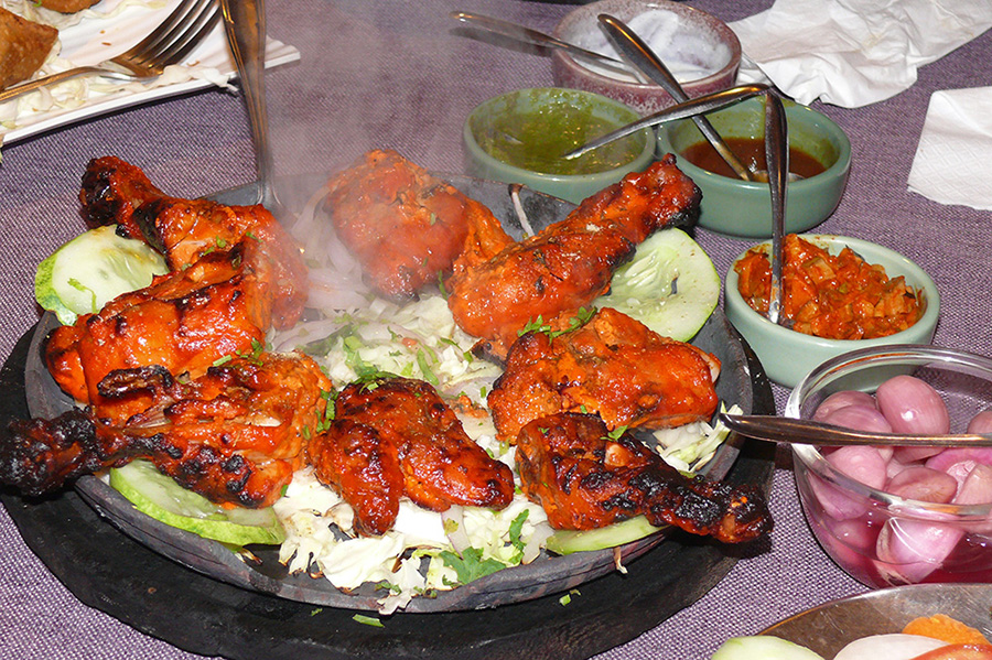 Tandoori Chicken simmering on the hot plate.
