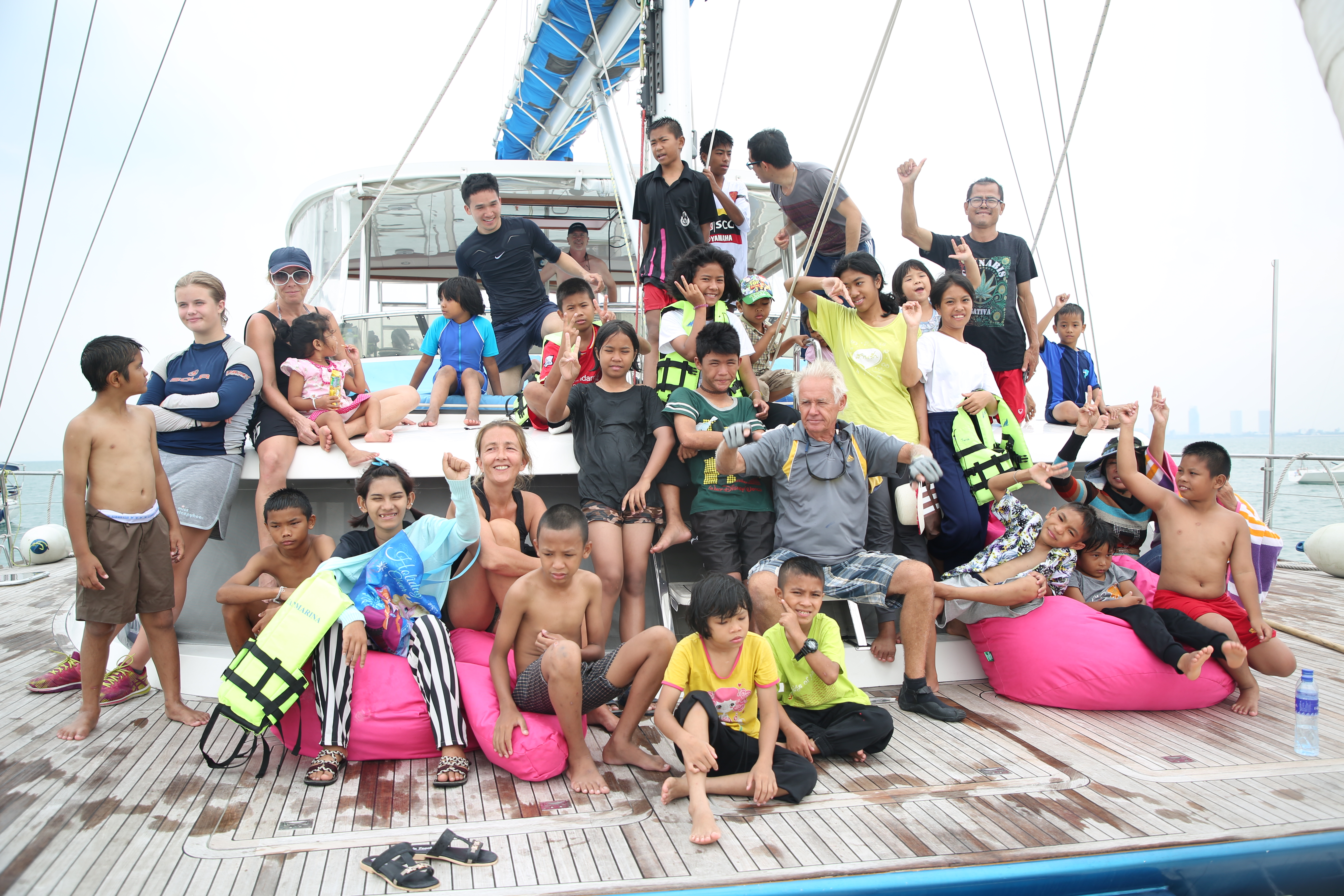 Orphans and more experienced deckhands pose for a photo on one of the luxury yachts.