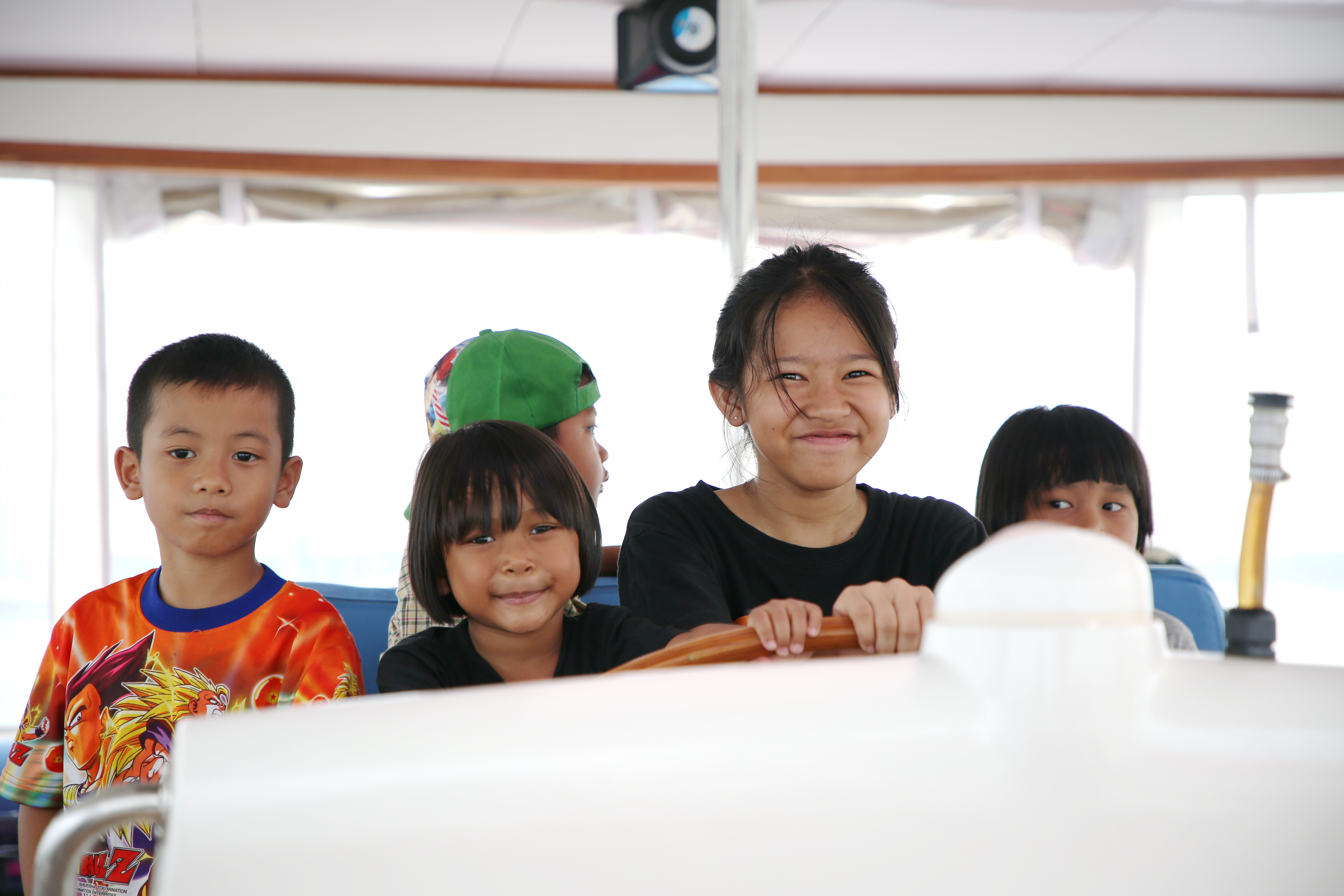 All hands to the wheel – children from the Camillian Center steer for home.