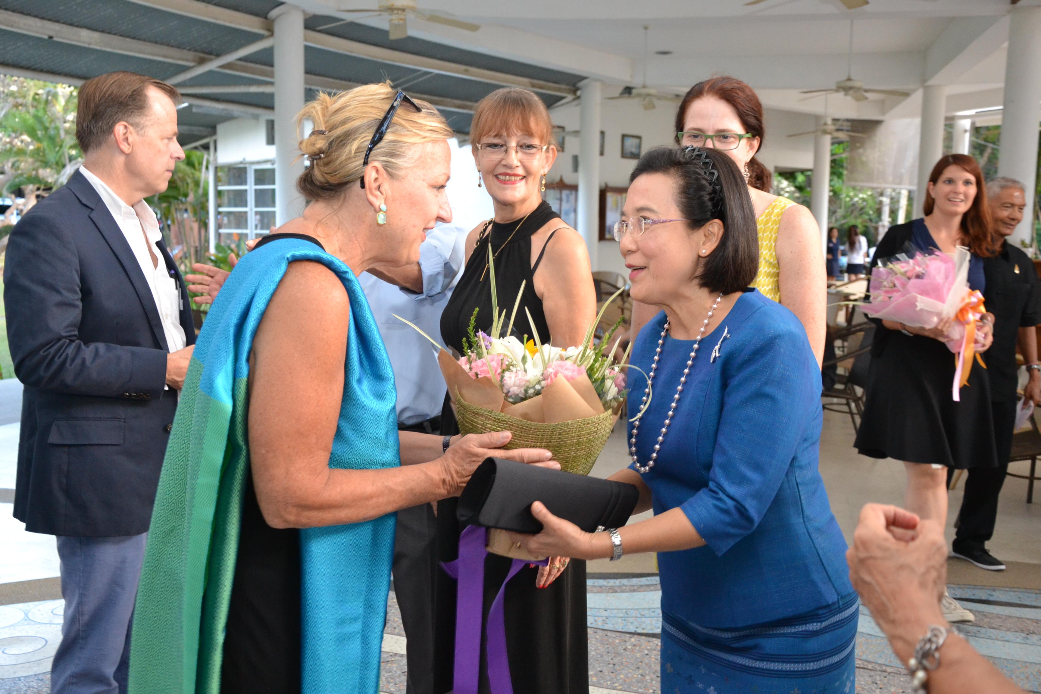 Radchada Chomjinda presents a lovely bouquet to Jacqueline Davies.