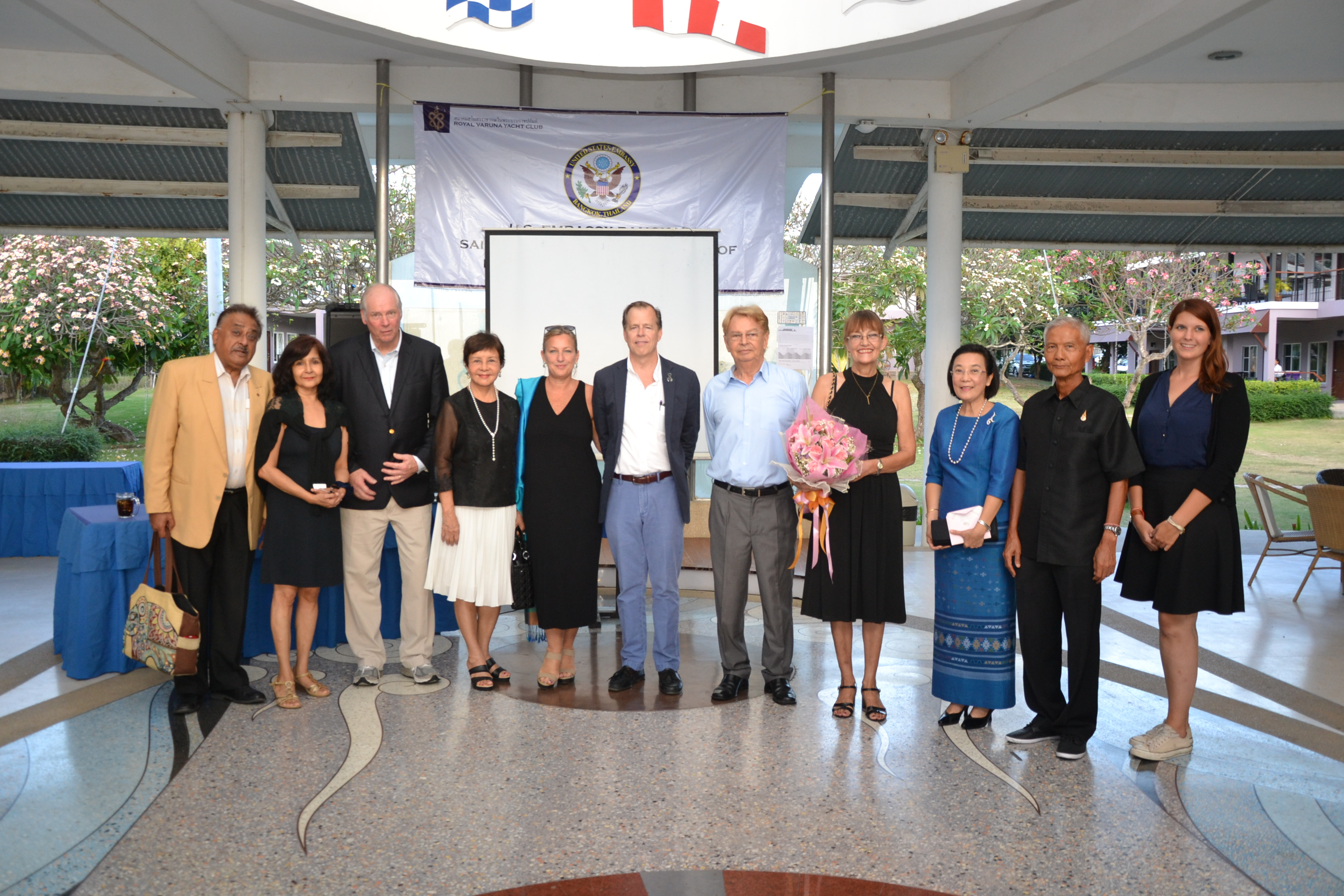Ambassador Davies, Jackie and Gary Jobson pose for photos with community leaders.