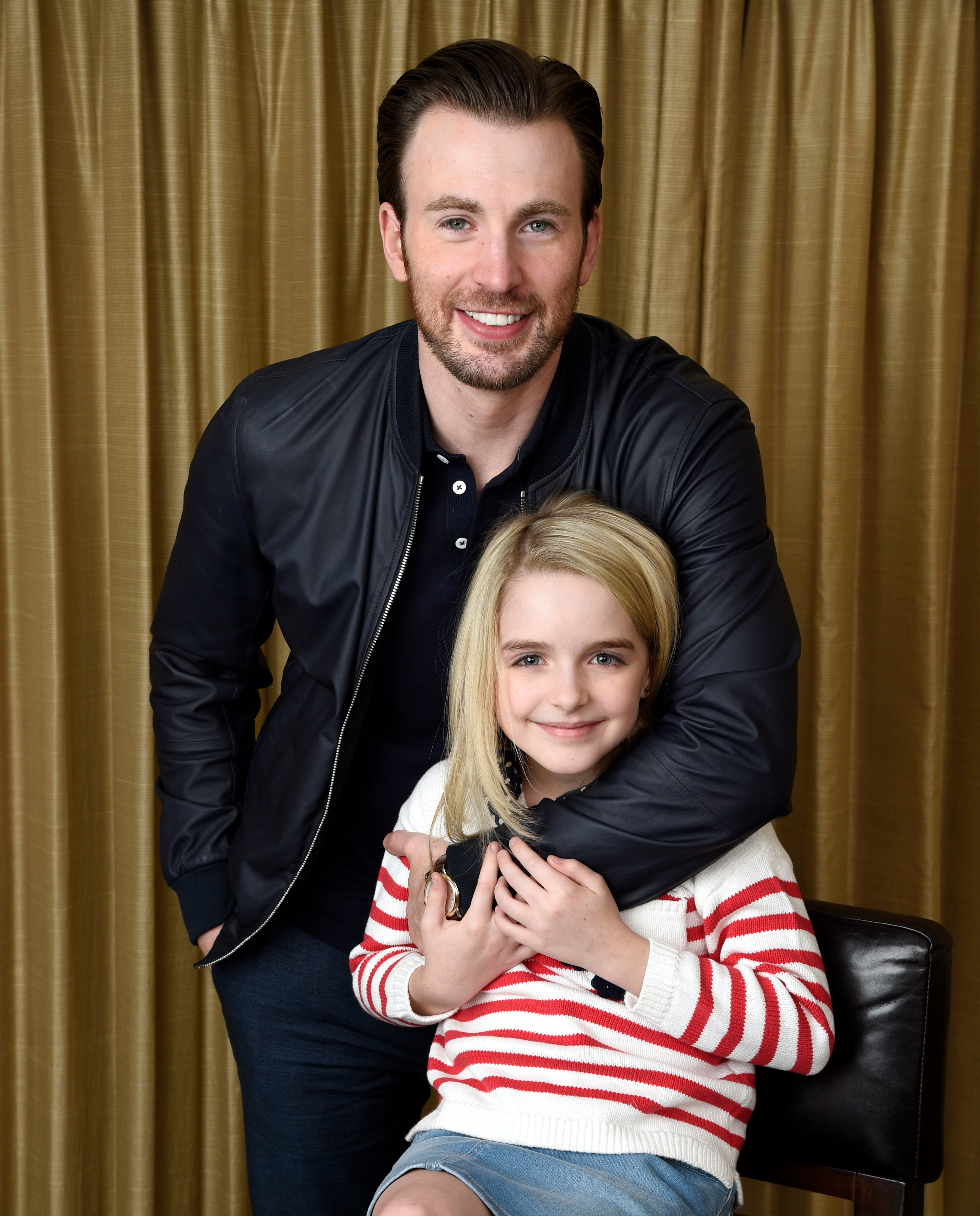 "Chris Evans and McKenna Grace, cast members in the film ""Gifted,"" pose for a portrait at the Four Seasons Hotel in Los Angeles. (Photo by Chris Pizzello/Invision/AP)"
