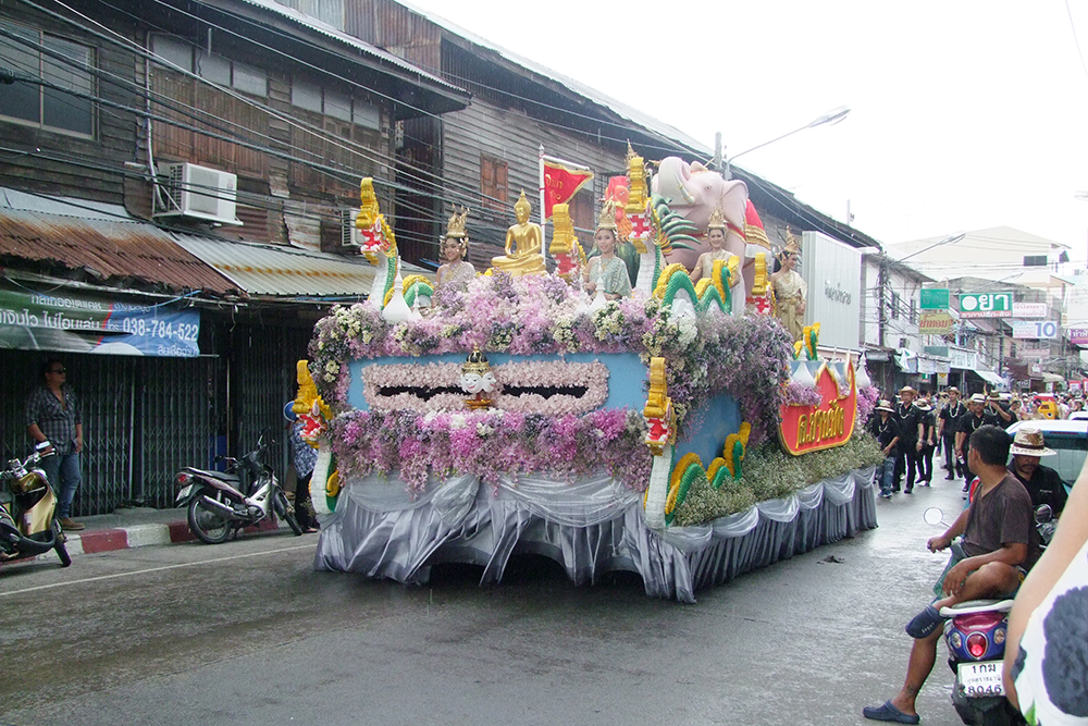 Chonburi's April 13 parade included 12 floats and vehicles carrying Buddhist relics on which people can pour holy water.