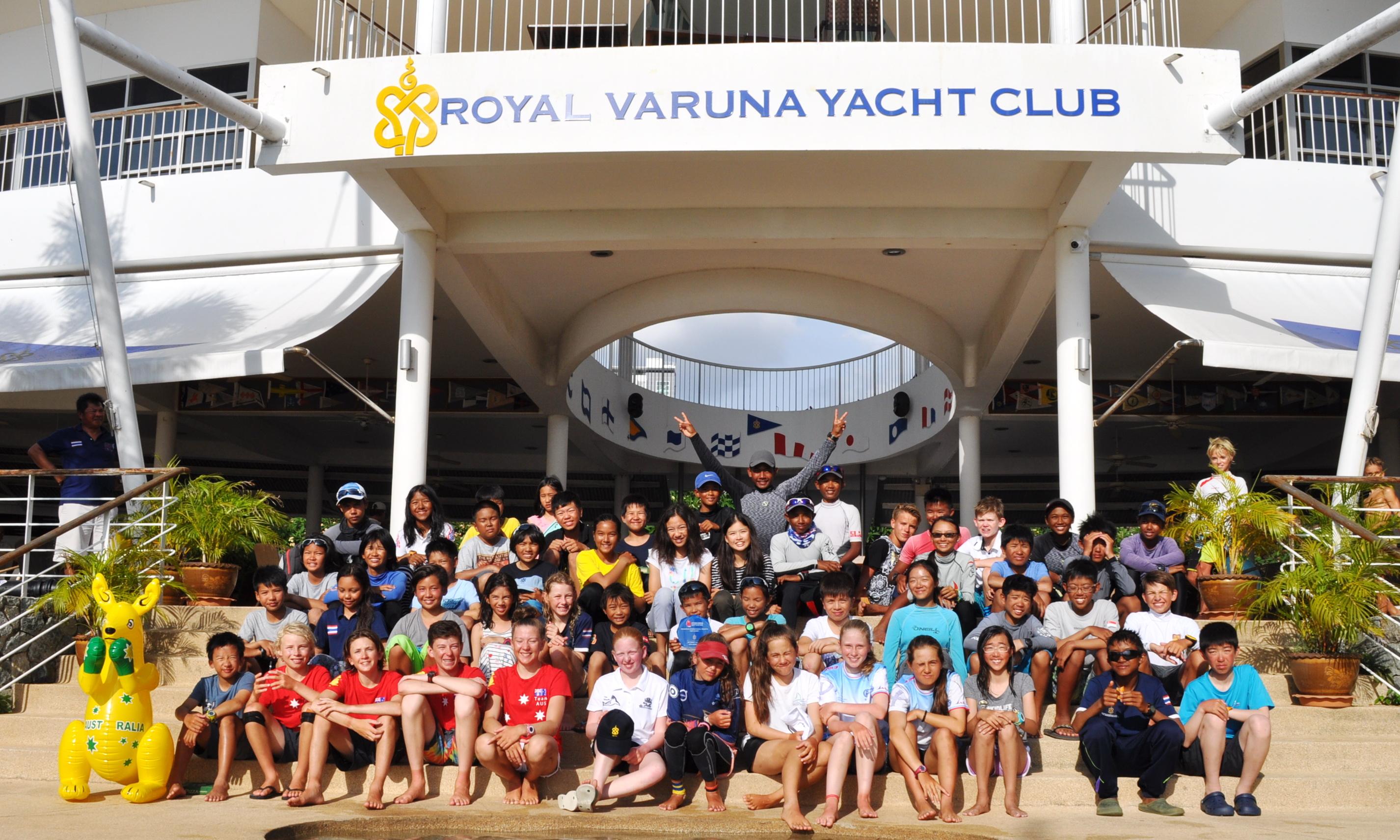 Young Thai and international sailors pose for a group photo at Royal Varuna Yacht Club.