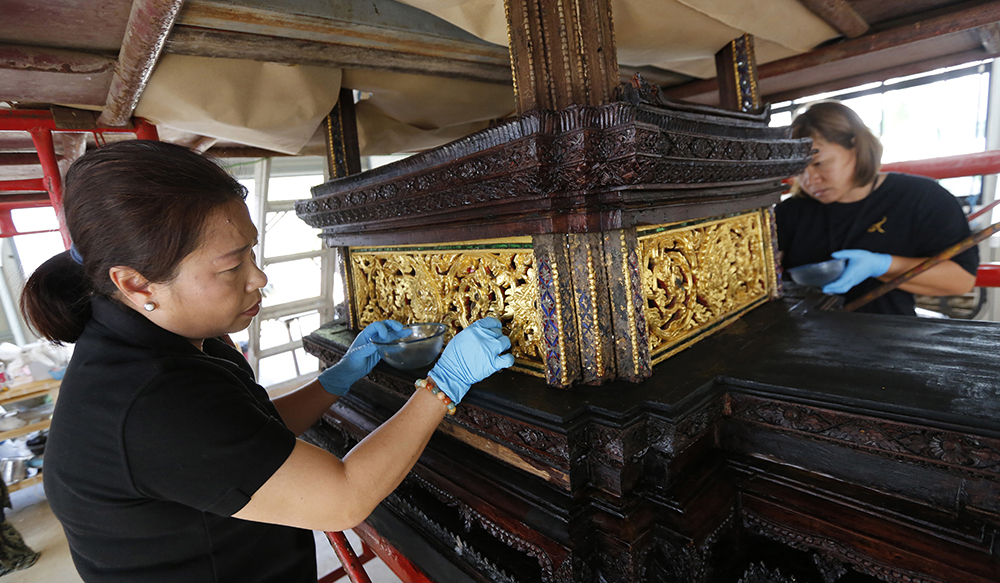 Artisans clean the royal funeral chariot to be used as part of the cremation for the late Thai King Bhumibol Adulyadej. (AP Photo/Sakchai Lalit)