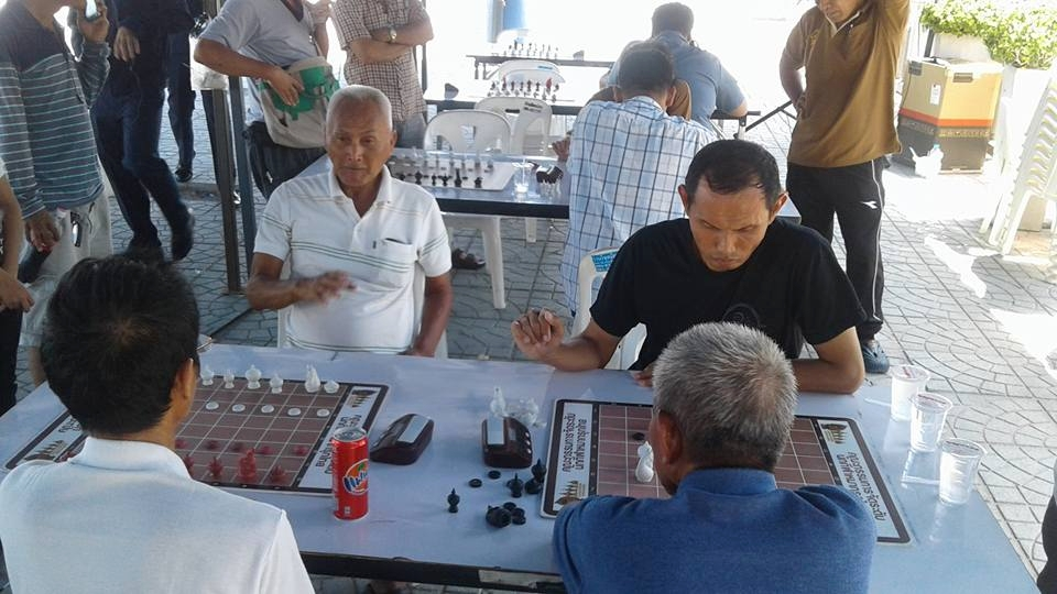 Board games have their place during the festivities in Naklua.