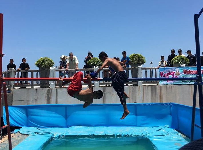 Youngsters battle in the traditional Muay Talay (Sea Boxing) competition – stay on the pole and you win, fall off and you lose.