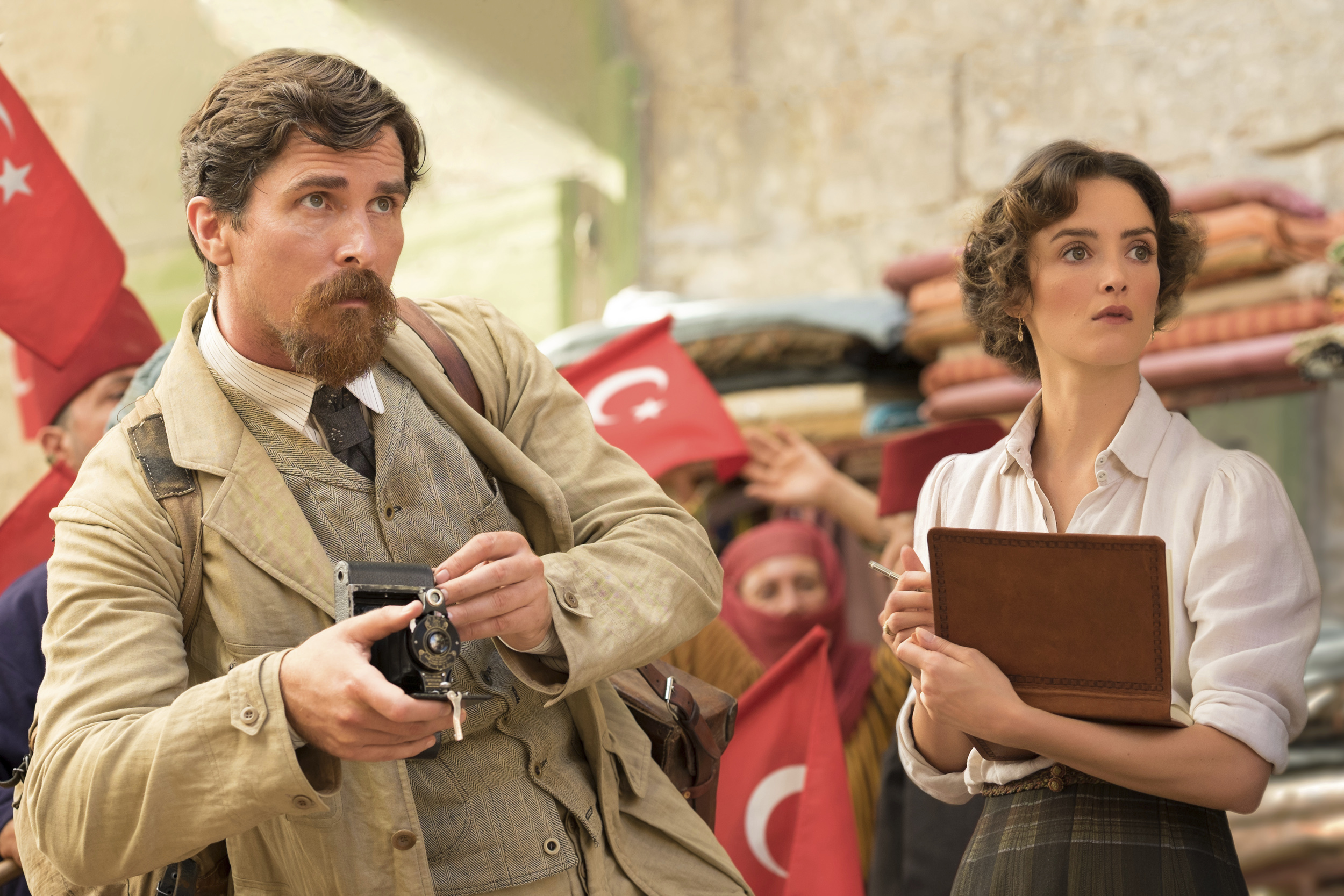"""This image shows Christian Bale (right) and Charlotte Le Bon in a scene from """"The Promise."""" (Jose Haro/Open Road Films via AP)"""