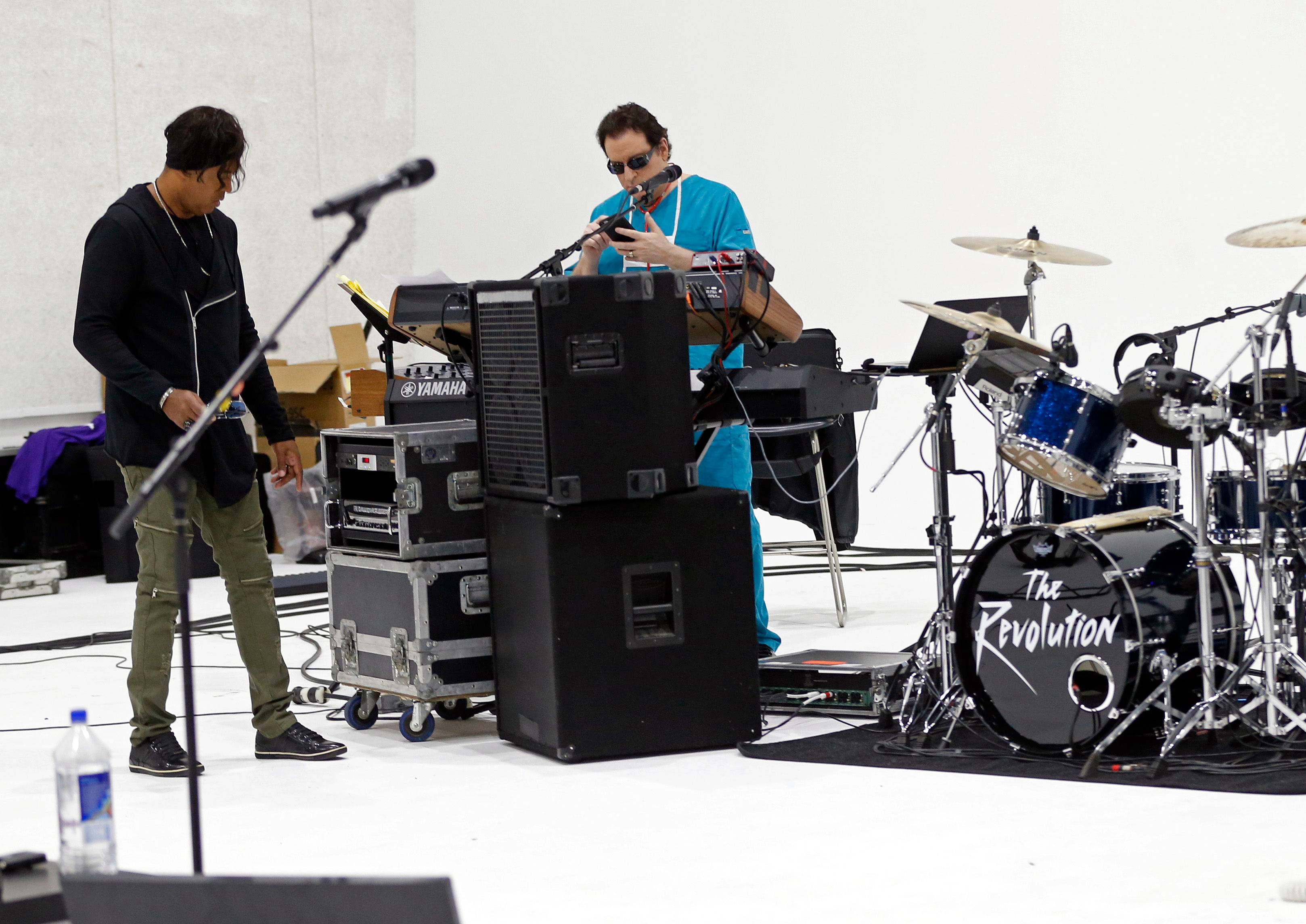 Members of Prince's 1980's band The Revolution, keyboarder Matt Fink (right) and bassist BrownMark, prepare for rehearsals Wednesday, April 19, at a studio in Minneapolis. (AP Photo/Jim Mone)