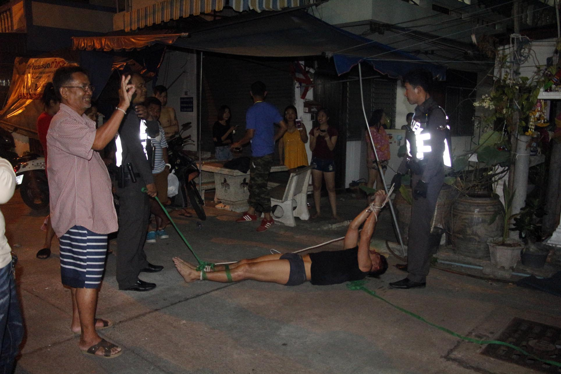 A Brit in boxers was hog-tied by angry Pattaya residents after he got drunk and ran across their roofs, shouting like a maniac.