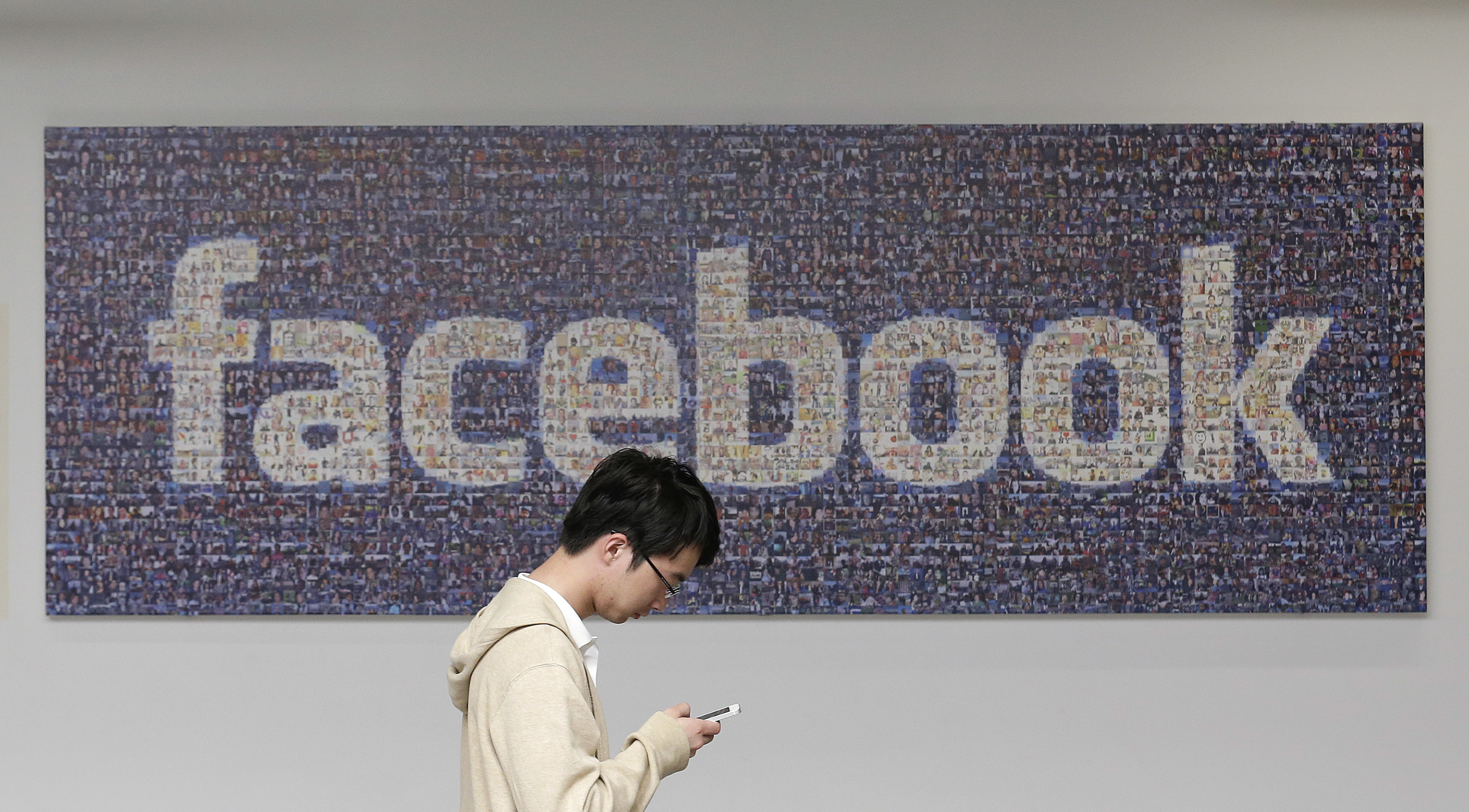 Facebook announced Thursday, April 6, 2017, it is launching a tool to help users spot false news articles on the site. (AP Photo/Jeff Chiu, File)