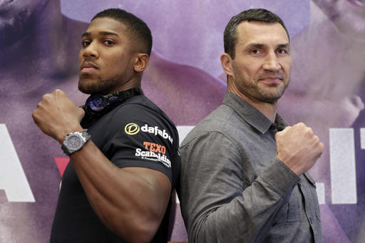 Anthony Joshua (left) and Wladimir Klitschko (right) will fight for the heavyweight boxing title at Wembley Stadium in London on Saturday, April 29. (AP Photo/Richard Drew)