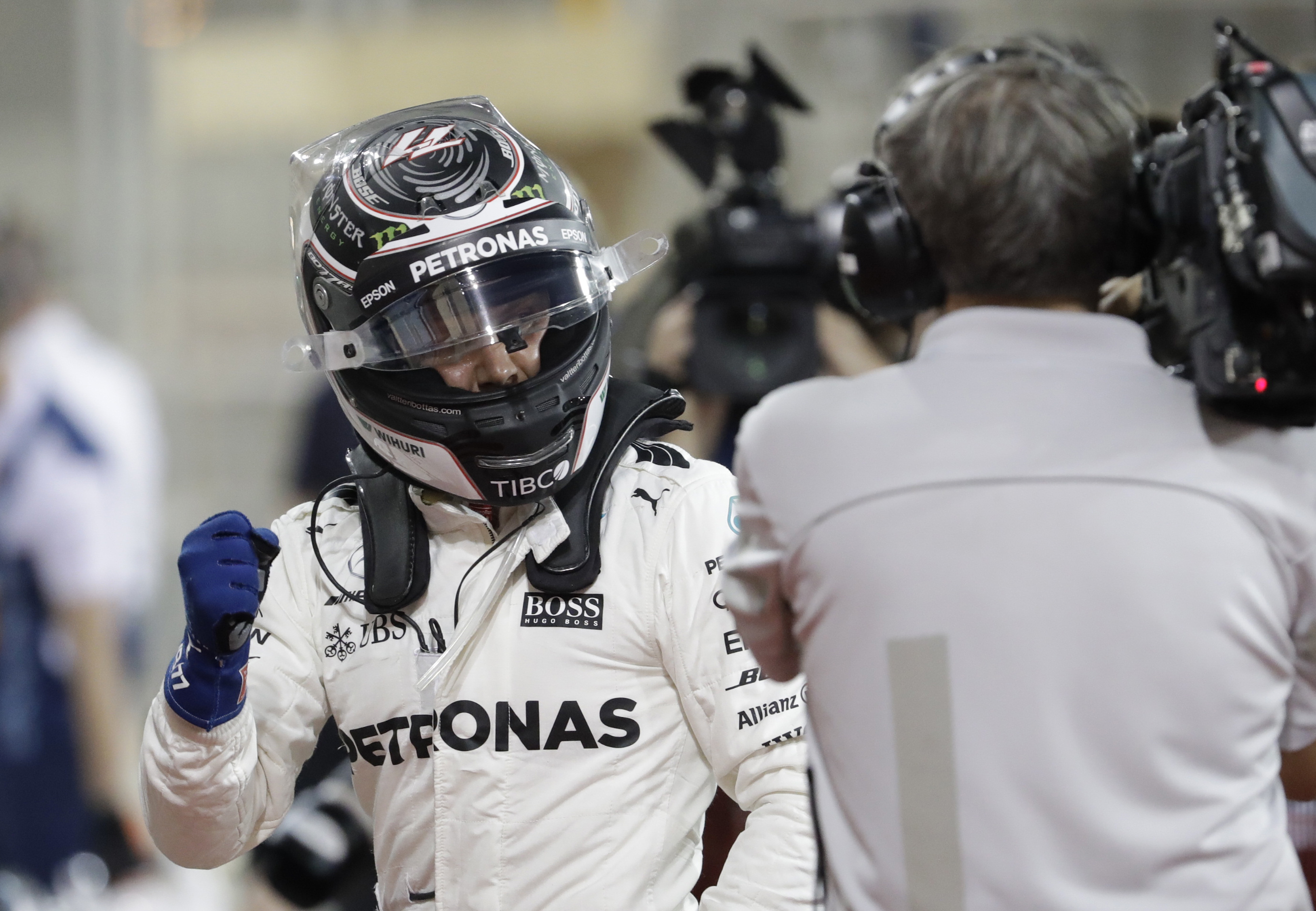 Mercedes driver Valtteri Bottas of Finland gestures after he clocked the fastest time during qualifying for the Bahrain Formula One Grand Prix, at the Bahrain International Circuit in Sakhir, Bahrain, Saturday, April 15. (AP Photo/Luca Bruno)