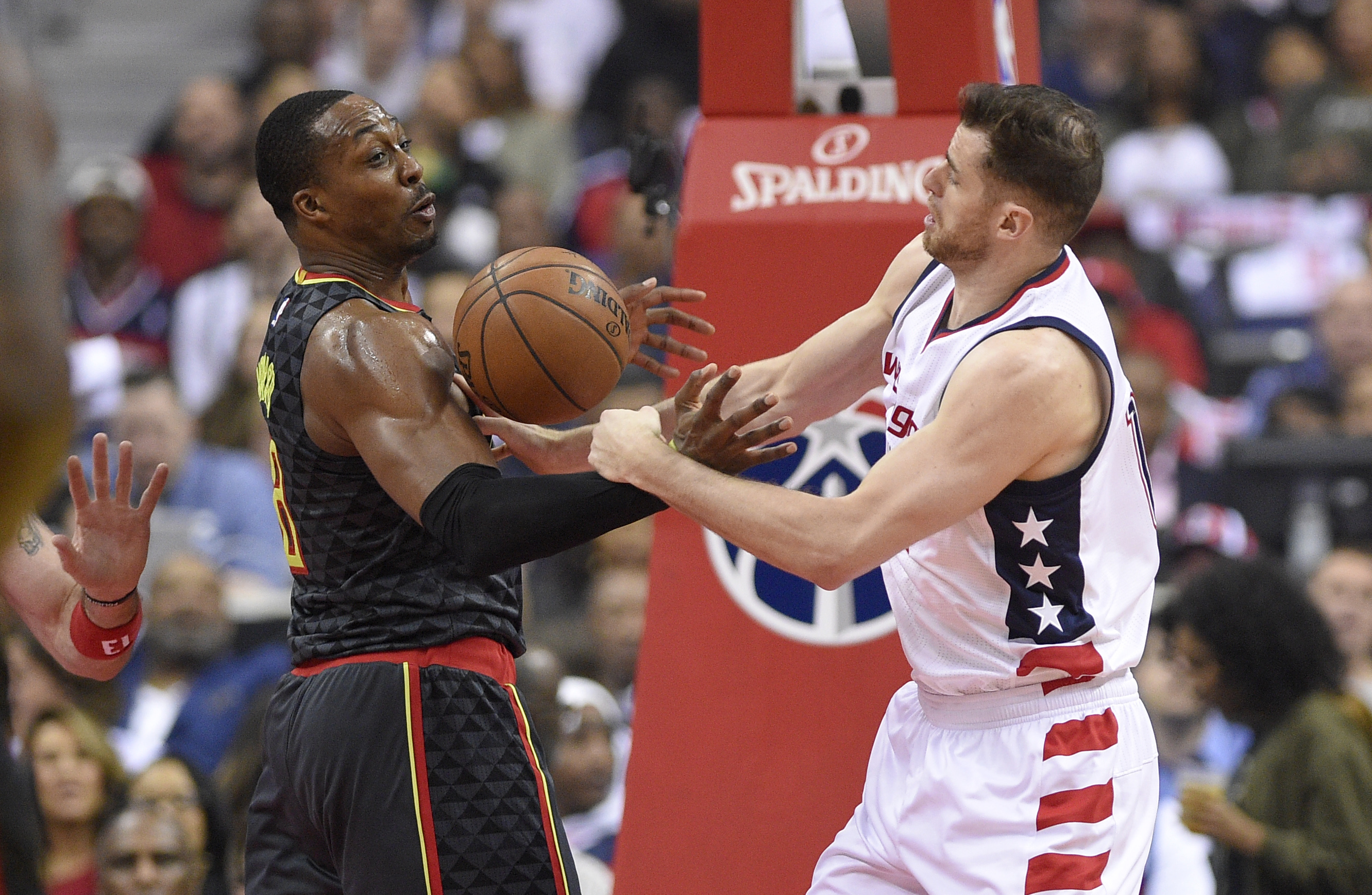 Washington Wizards forward Jason Smith, right, and Atlanta Hawks center Dwight Howard, left, reach for the ball during Game 2 of their first-round NBA basketball playoff series, Wednesday, April 19, in Washington. (AP Photo/Nick Wass)