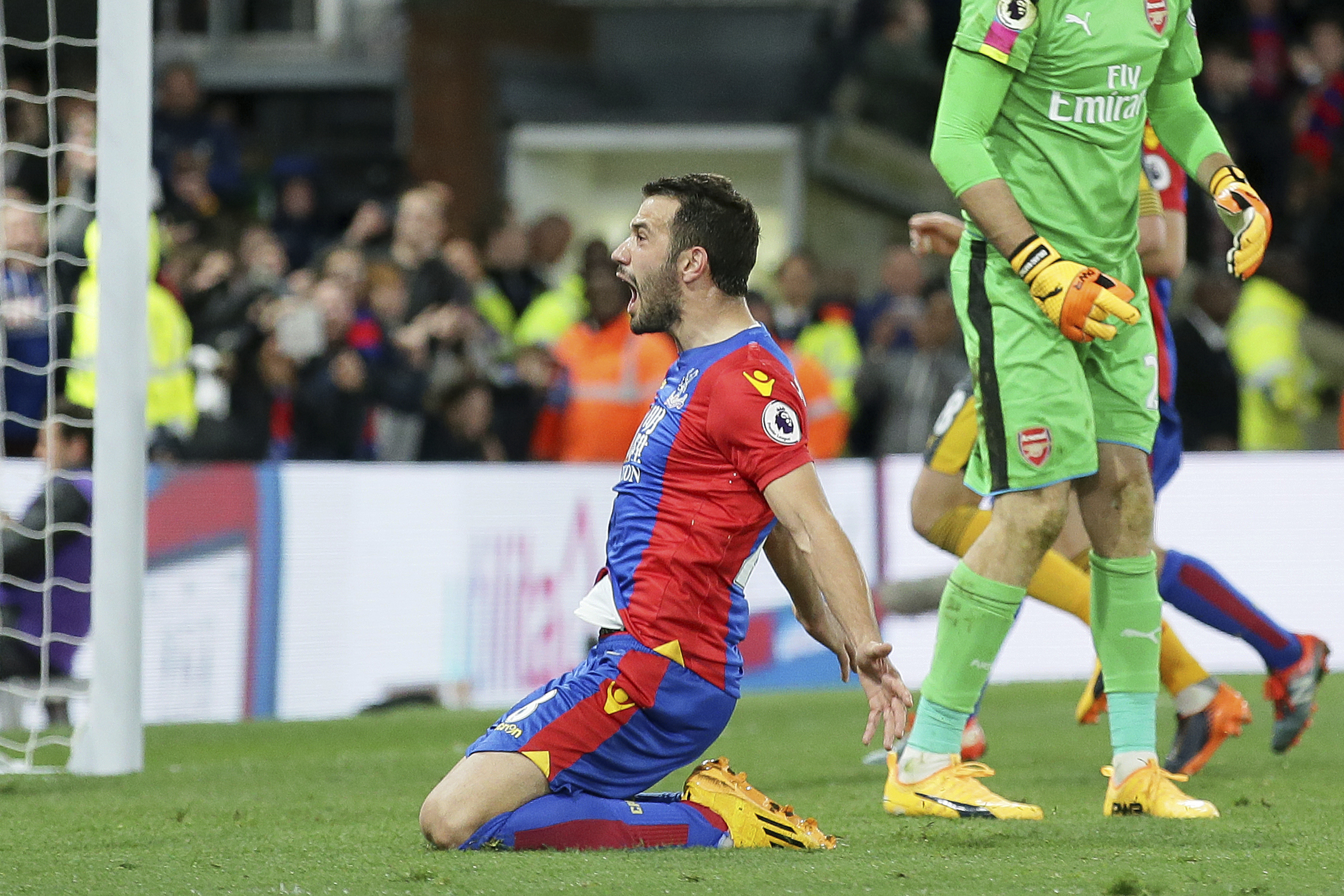 Crystal Palace's Luka Milivojevic celebrates after scoring a penalty during the English Premier League match against Arsenal at Selhurst Park in London, Monday April 10. (AP Photo/Tim Ireland)