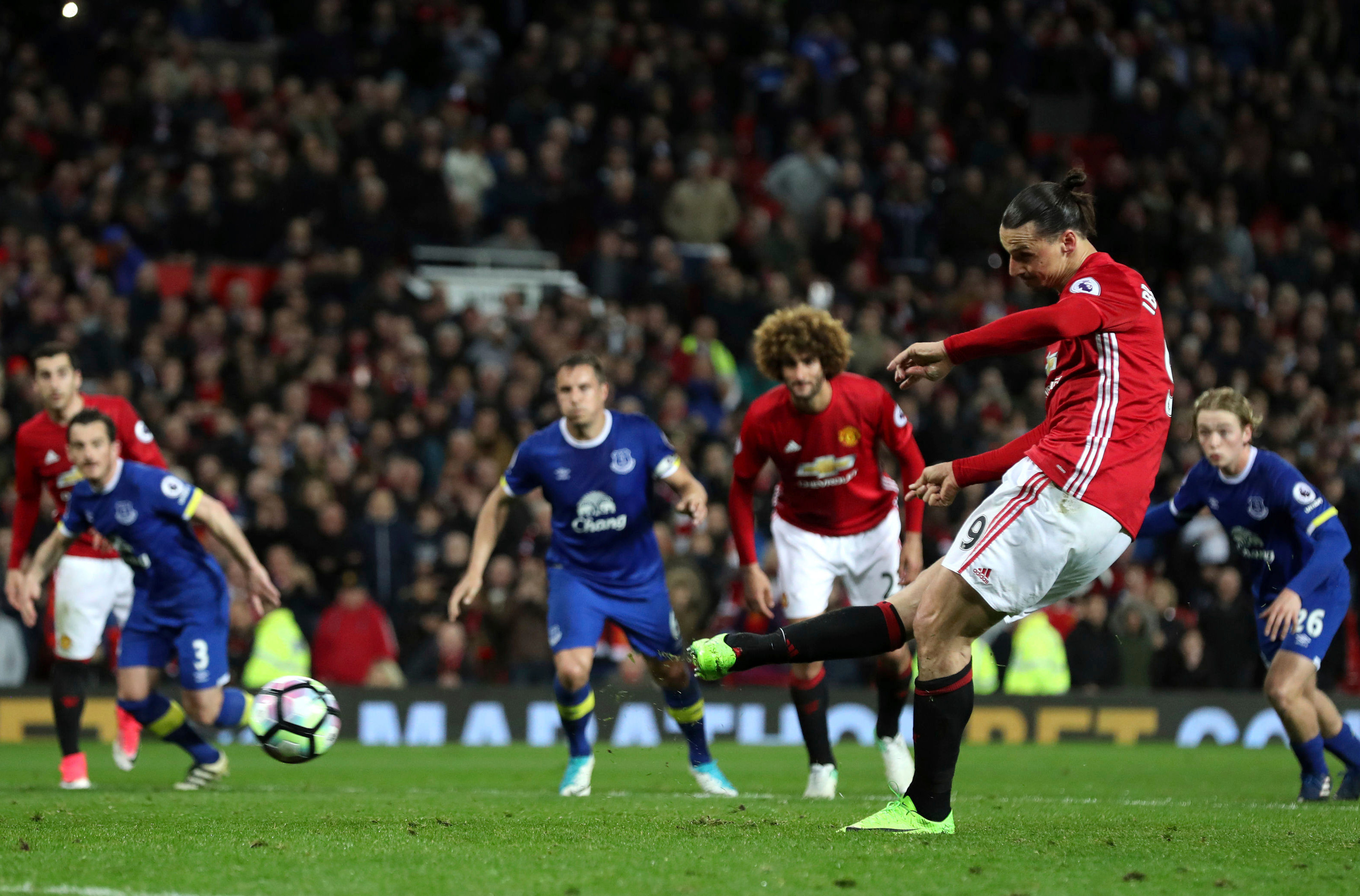 Manchester United's Zlatan Ibrahimovic scores from the penalty spot against Everton during their English Premier League match at Old Trafford in Manchester, Tuesday April 4. (Martin Rickett/PA via AP)