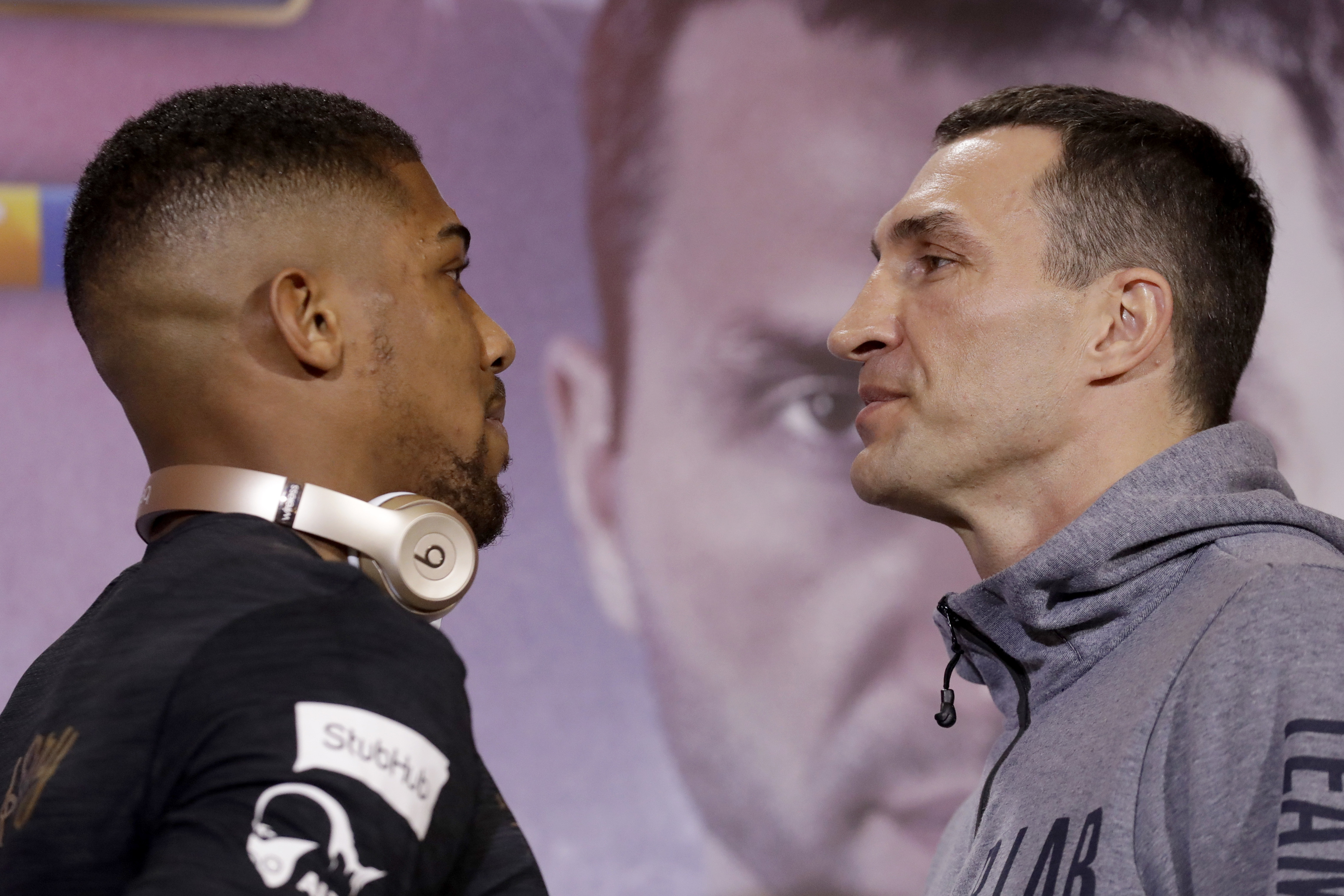 British boxer Anthony Joshua, left, and Ukrainian boxer Wladimir Klitschko pose head-to-head for the media at the end of a press conference at Sky studios in west London, Thursday, April 27. They are due to fight for the IBF heavyweight world title on Saturday at Wembley stadium in London. (AP Photo/Matt Dunham)