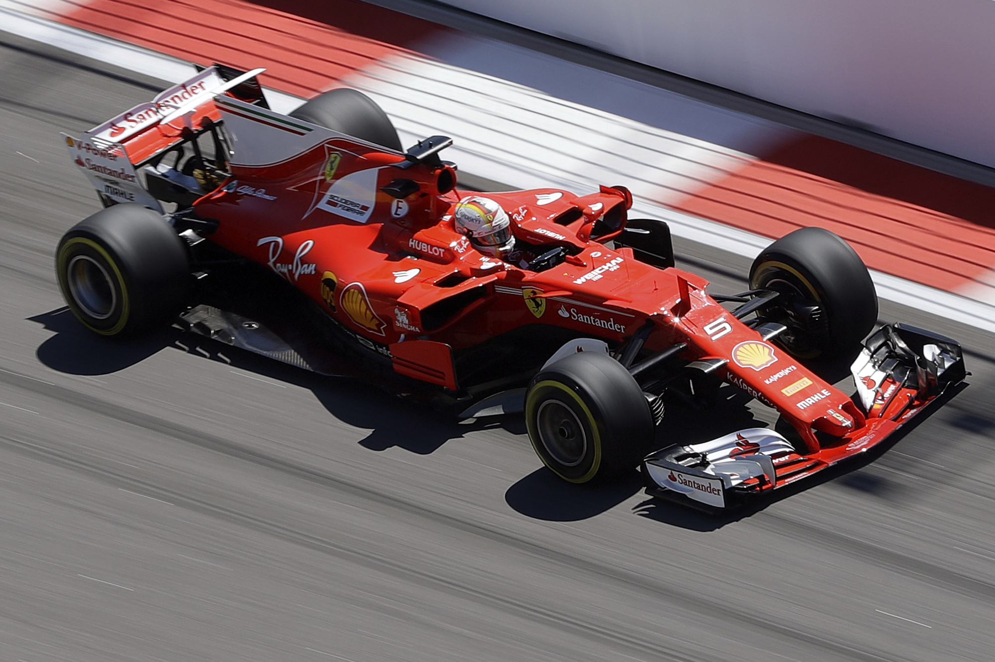 Ferrari driver Sebastian Vettel of Germany steers his car during the first practice session ahead the Formula One Russian Grand Prix at the 'Sochi Autodrom' circuit, in Sochi, Russia, Friday, April. 28. (AP Photo/Sergei Grits)