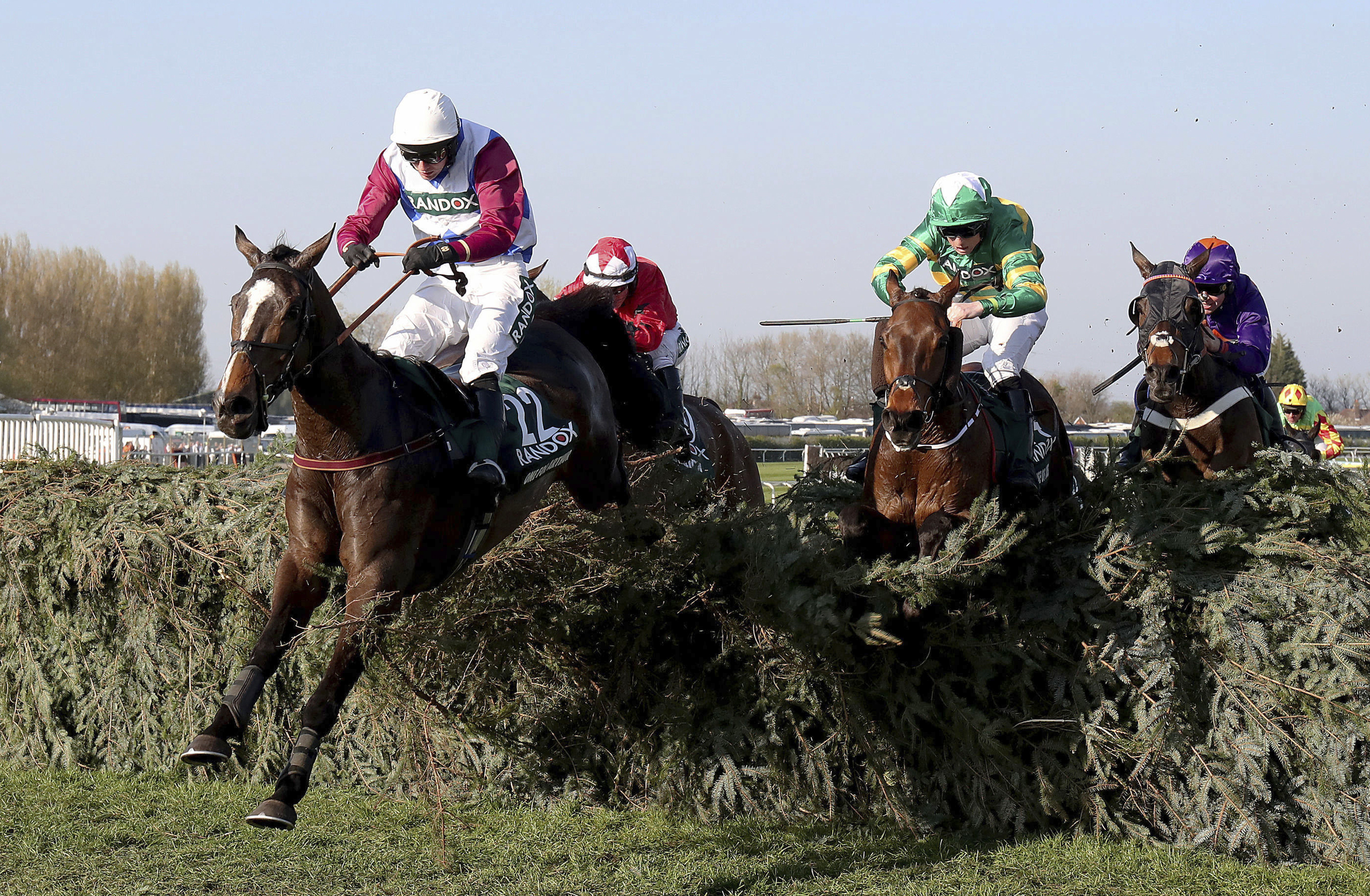 One For Arthur ridden by jockey Derek Fox jumps the last on the way to winning the Grand National horse race at Aintree Racecourse in Liverpool, England, Saturday April 8. (David Davies/PA via AP)